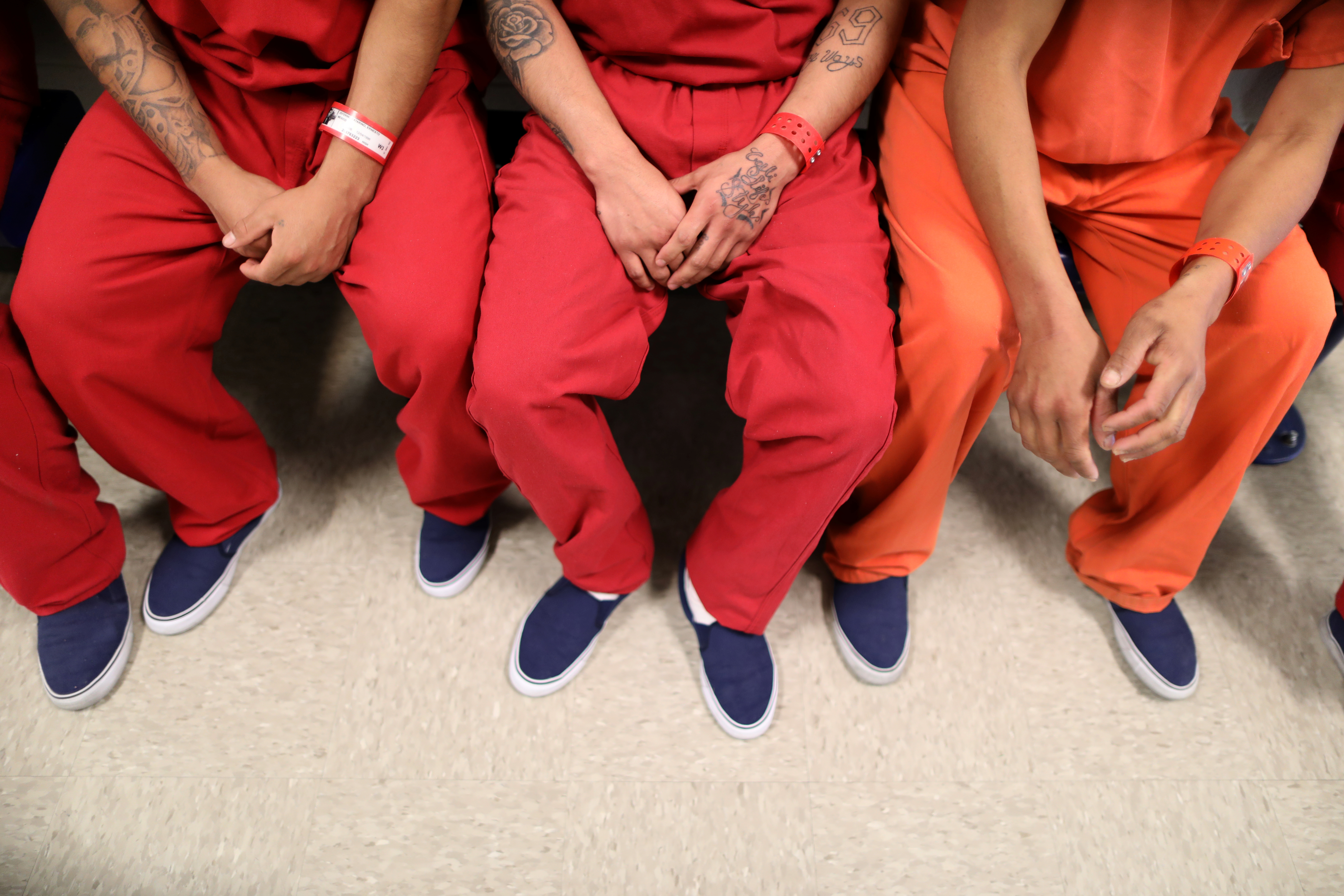 FILE - Immigration and Customs Enforcement detainees are seen at at a detention center in Adelanto, Calif., April 13, 2017.