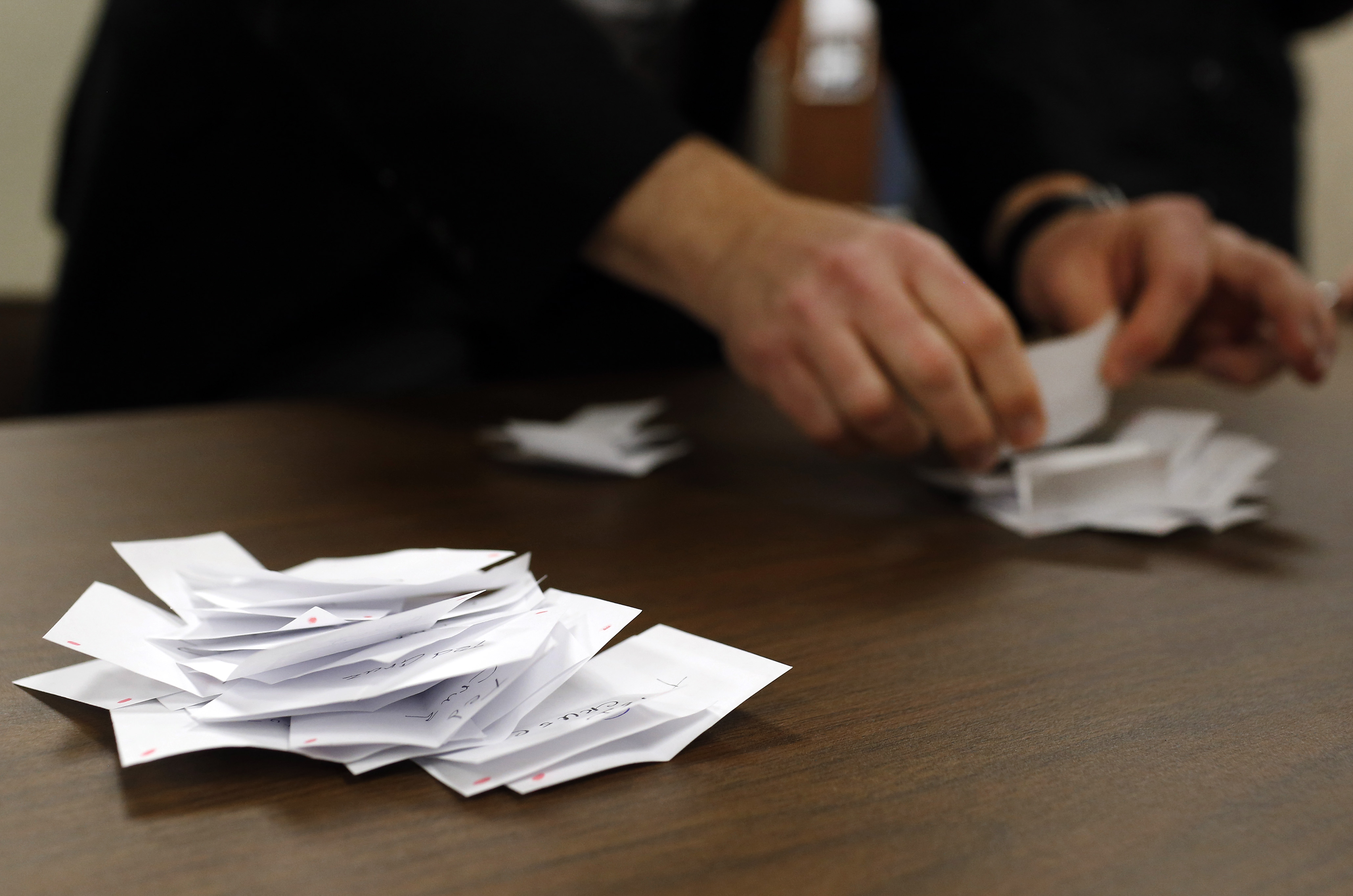 FILE - Precinct chair John Anderson counts votes for Republican candidates during a caucus in Nevada, Iowa, Monday, Feb. 1, 2016.