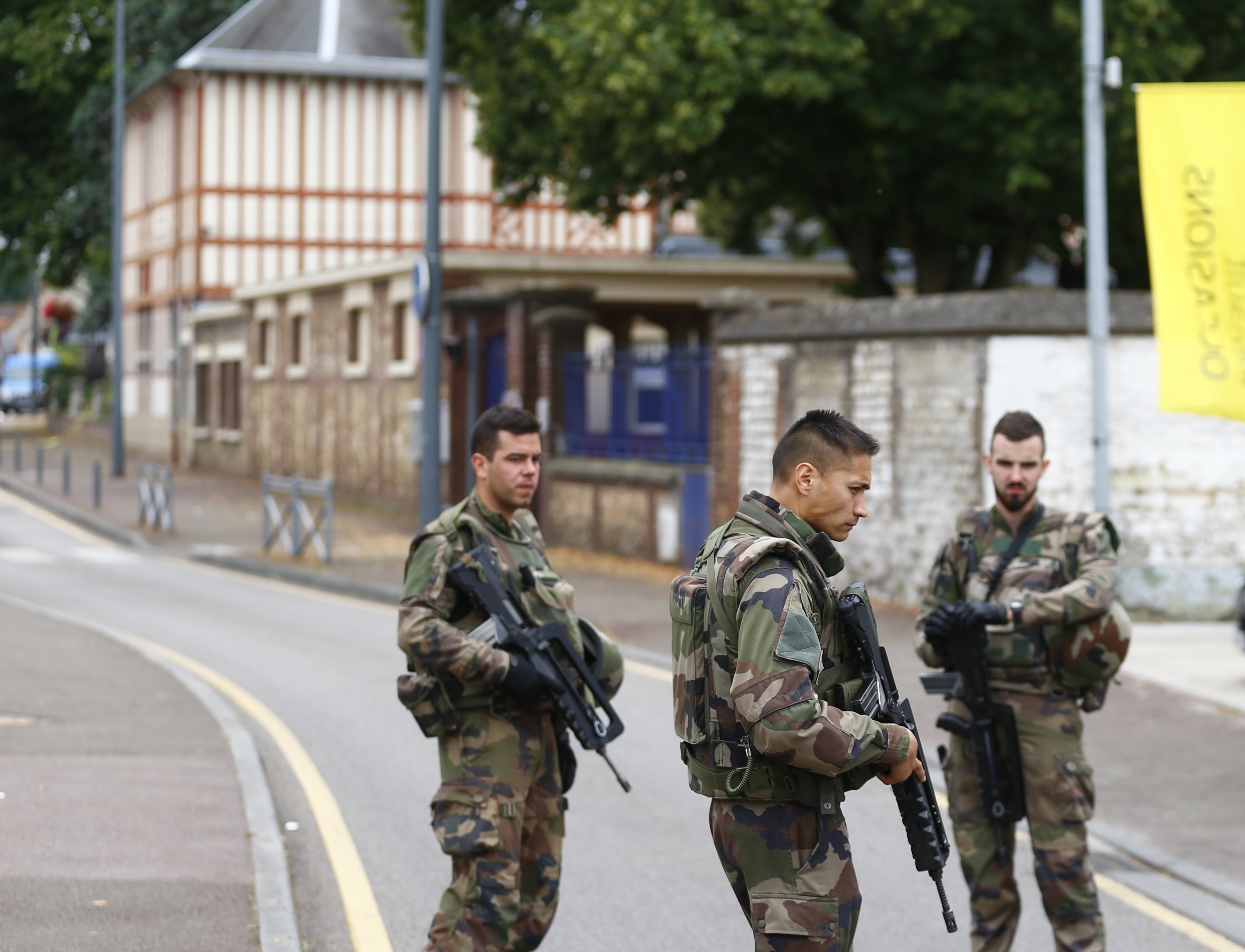 French soldiers stand guard as they prevent  the access to the scene of an attack in Saint Etienne du Rouvray, Normandy, France on July 26, 2016.