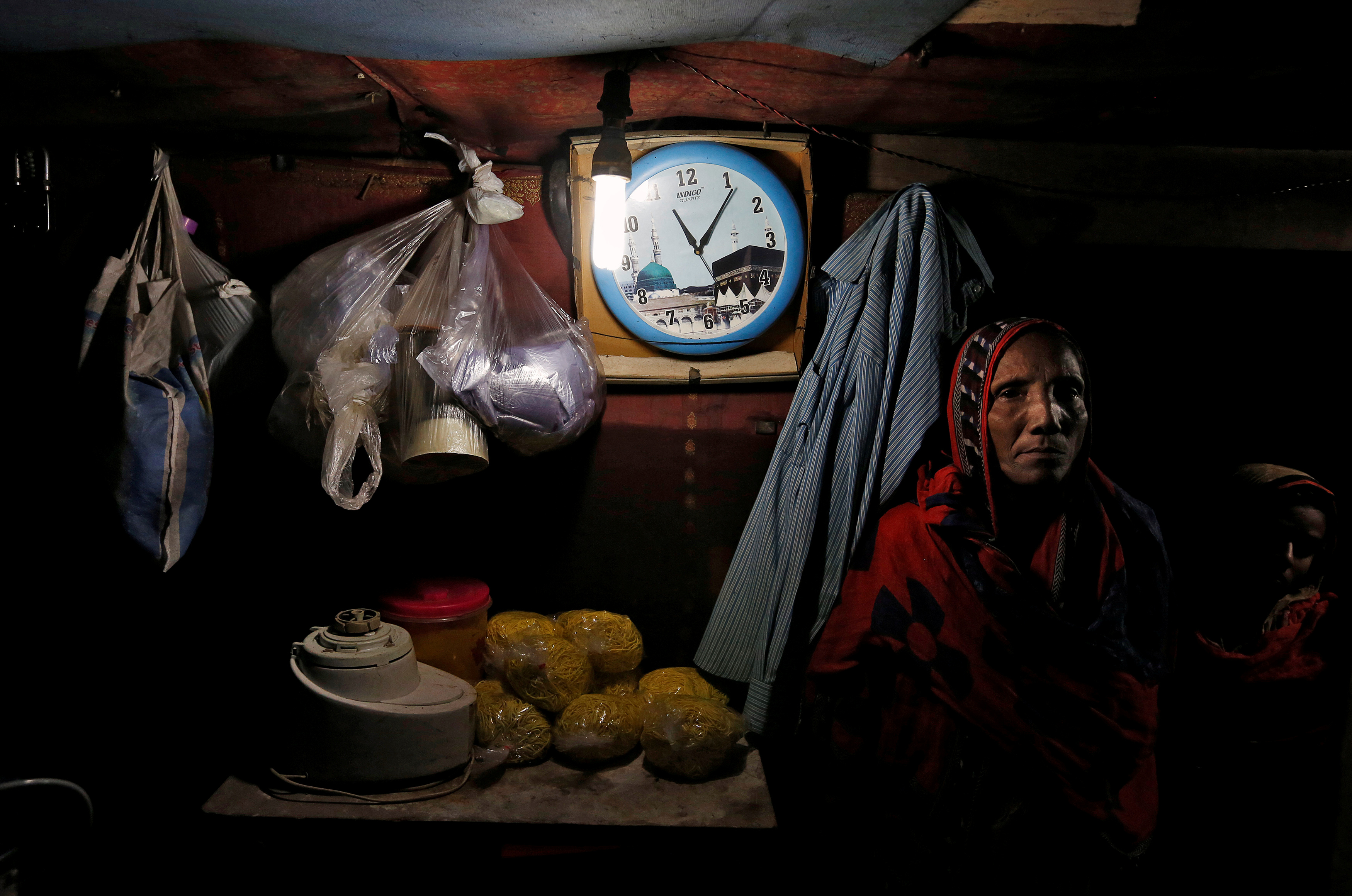 FILE - A family from the Rohingya community is pictured inside a shack in a camp in Delhi, India, Aug. 17, 2017.