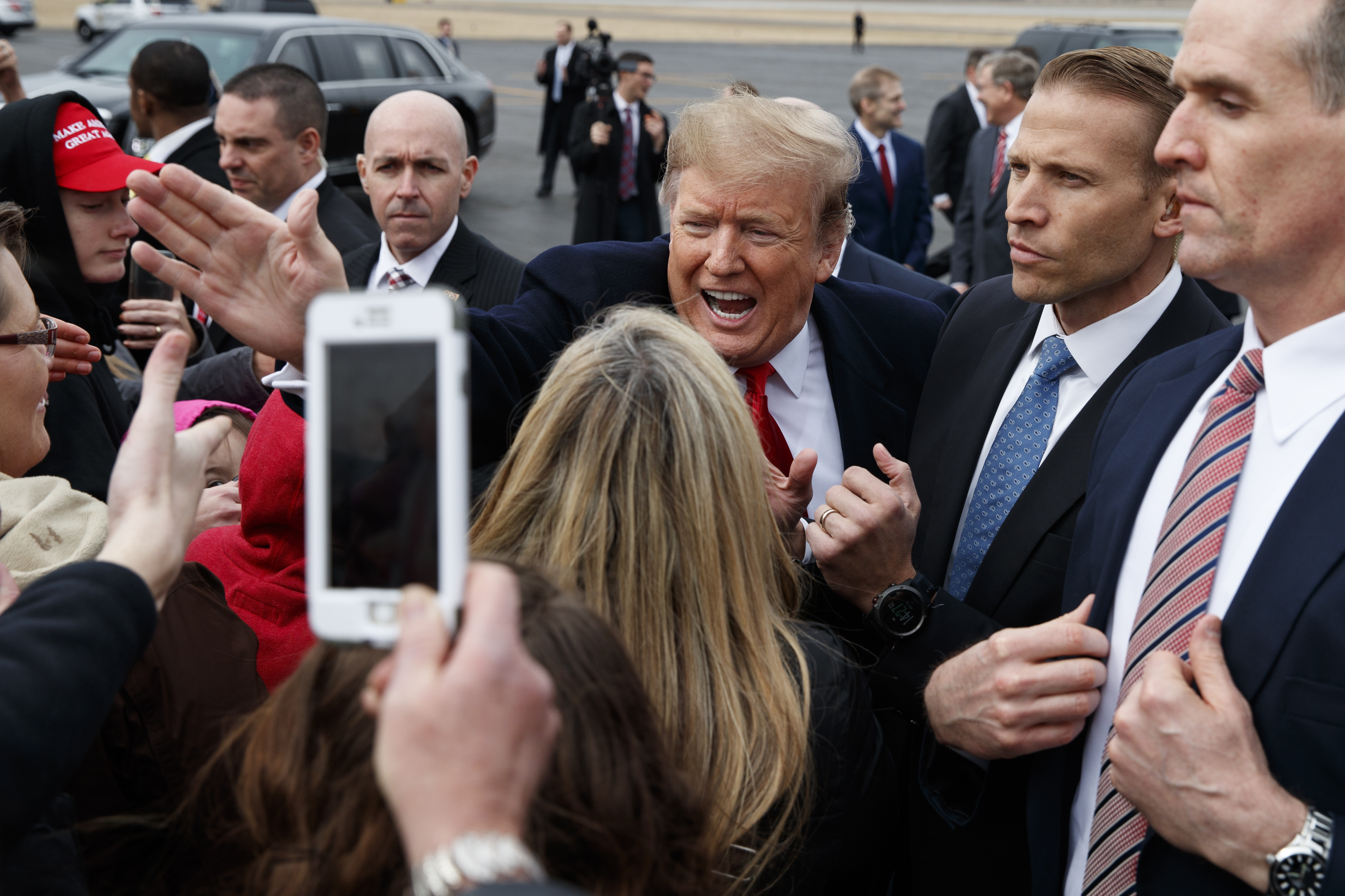 President Donald Trump shakes hands with supporters as he arrives at Lima Allen County Airport, March 20, 2019, in Lima, Ohio.