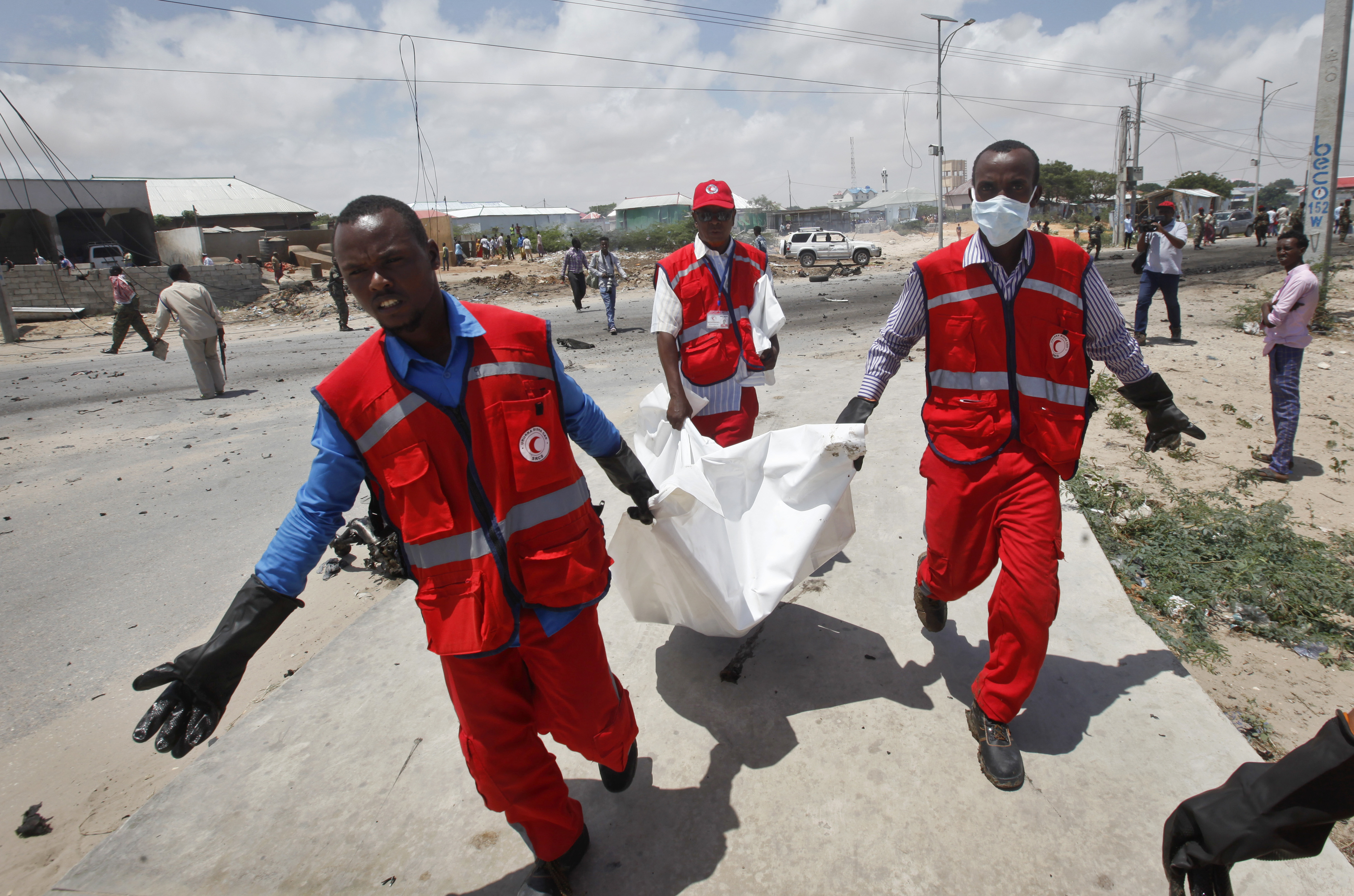 Somali Red Crescent workers carry away the body of a Somali civilian after an attack on a European Union military convoy in the capital Mogadishu, Somalia, Oct. 1, 2018.