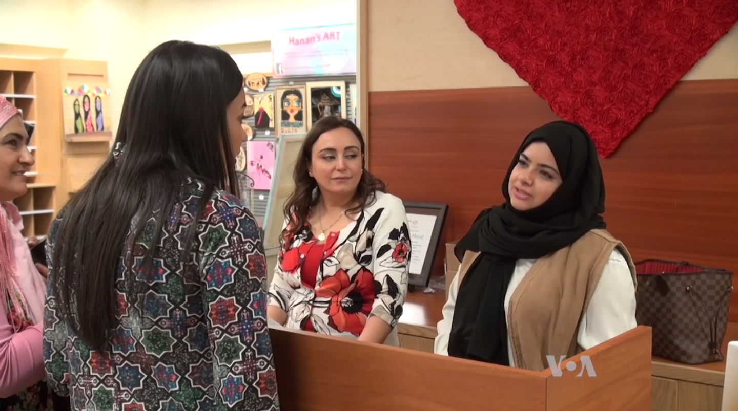 Graduate student Alyaa Al-Maadeed (facing right) helped organize the pop-up shop to help refugee women sell their handcrafted goods.