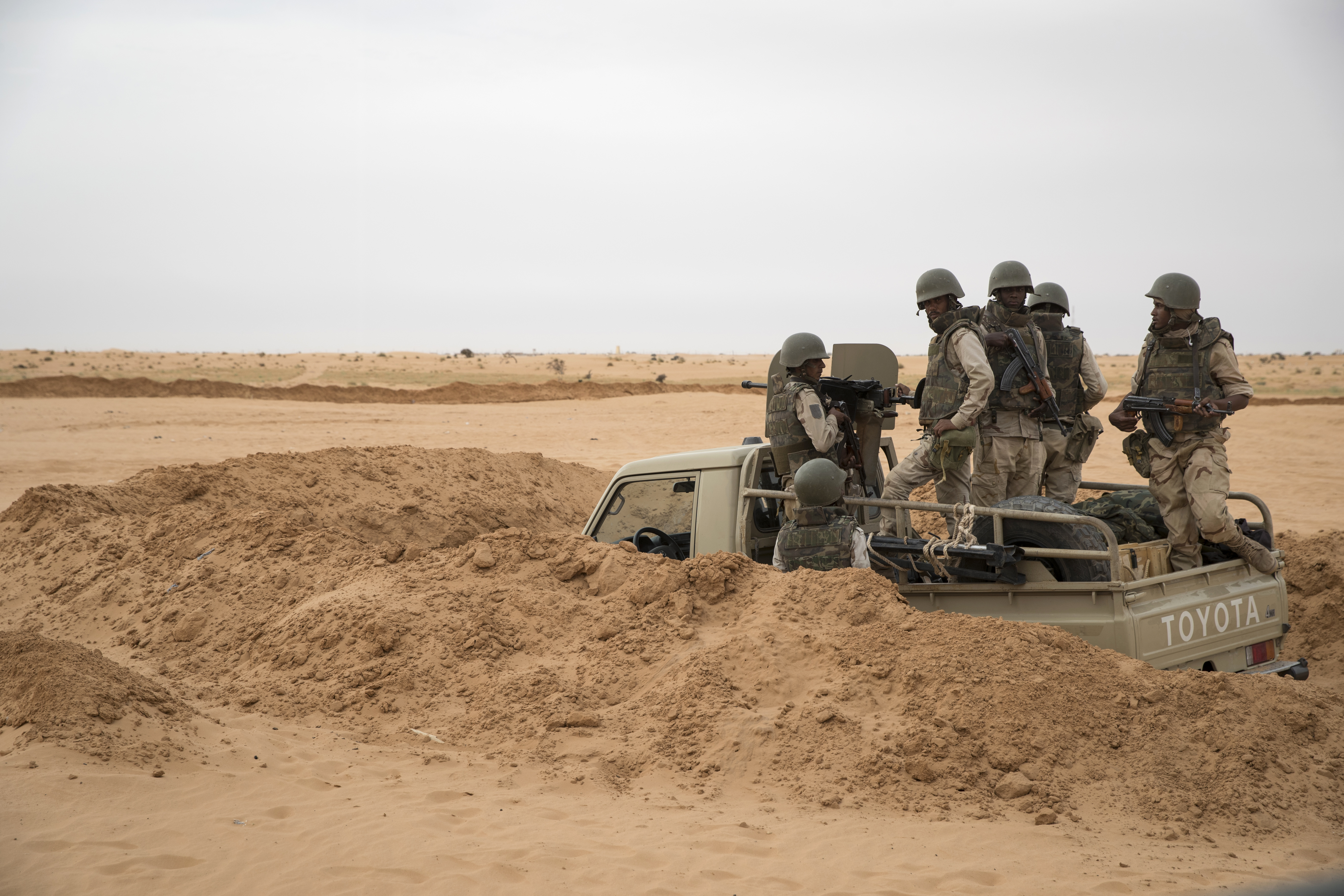 FILE - Soldiers of the Mauritania Army wait in an armed vehicle at a G5 Sahel task force outpost in the southeast of Mauritania, along the border with Mali, Nov. 22, 2018.