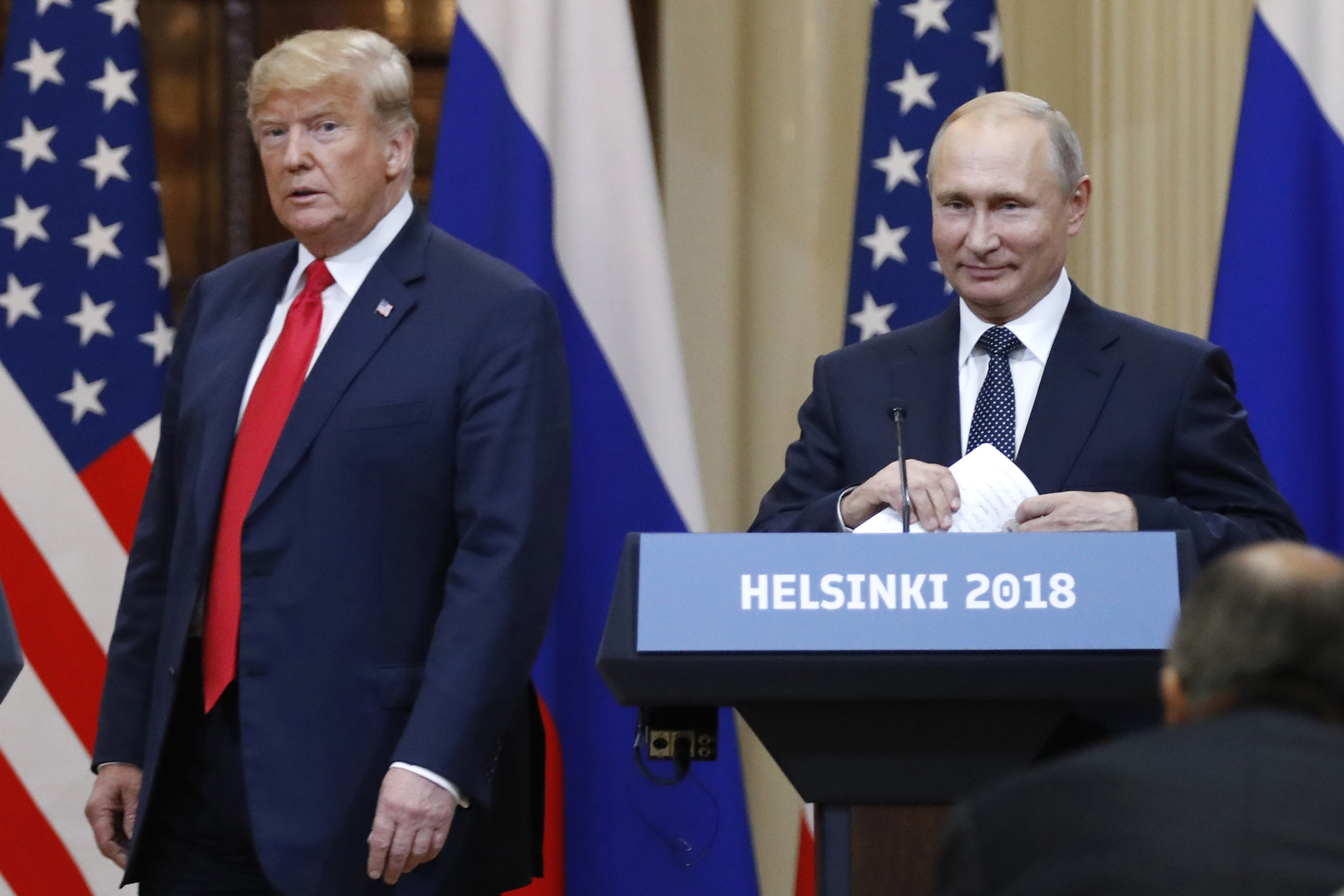 FILE - U.S. President Donald Trump, left, and Russian President Vladimir Putin arrive for a press conference after their meeting at the Presidential Palace in Helsinki, Finland, July 16, 2018.