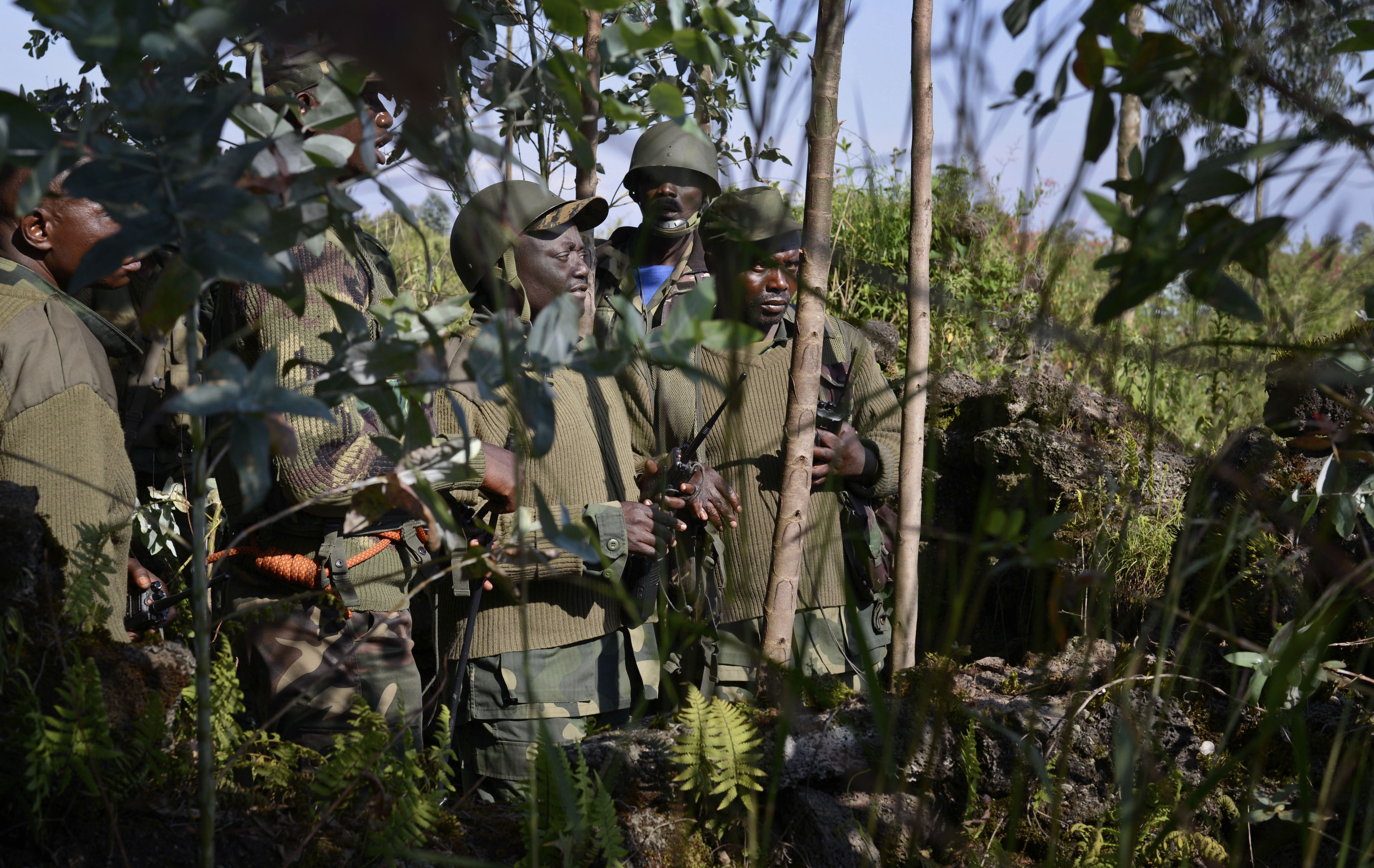FILE - FILE - Congolese army commanders discuss tactics near Kibumba Hill, which is occupied by M23 rebels, around 25kms from the provincial capital Goma, in eastern Congo.