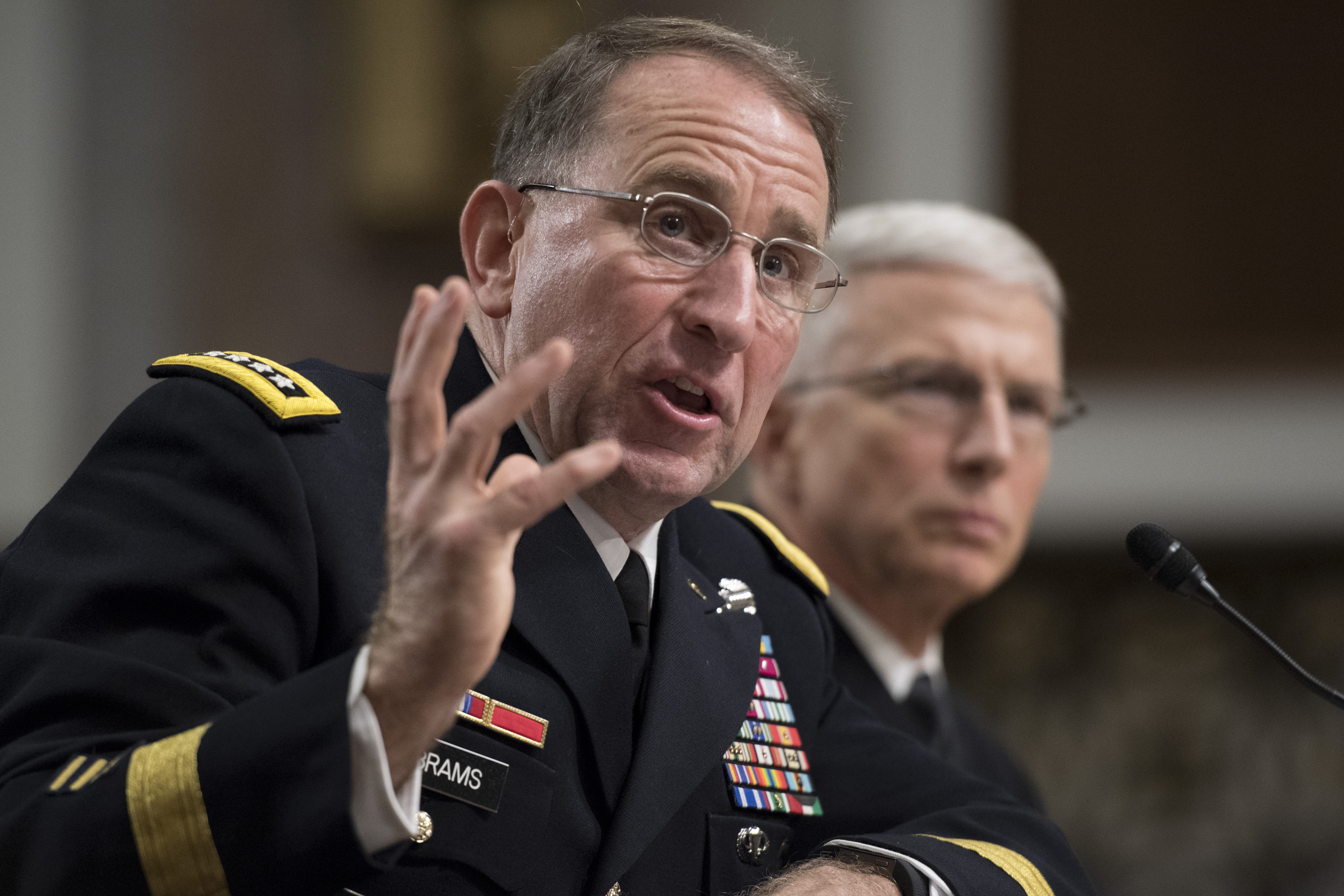 U.S. Army General Robert Abrams (L) testifies during his nomination hearing to be commander of all U.S. forces in Korea, on Capitol Hill in Washington, Sept. 25, 2018.