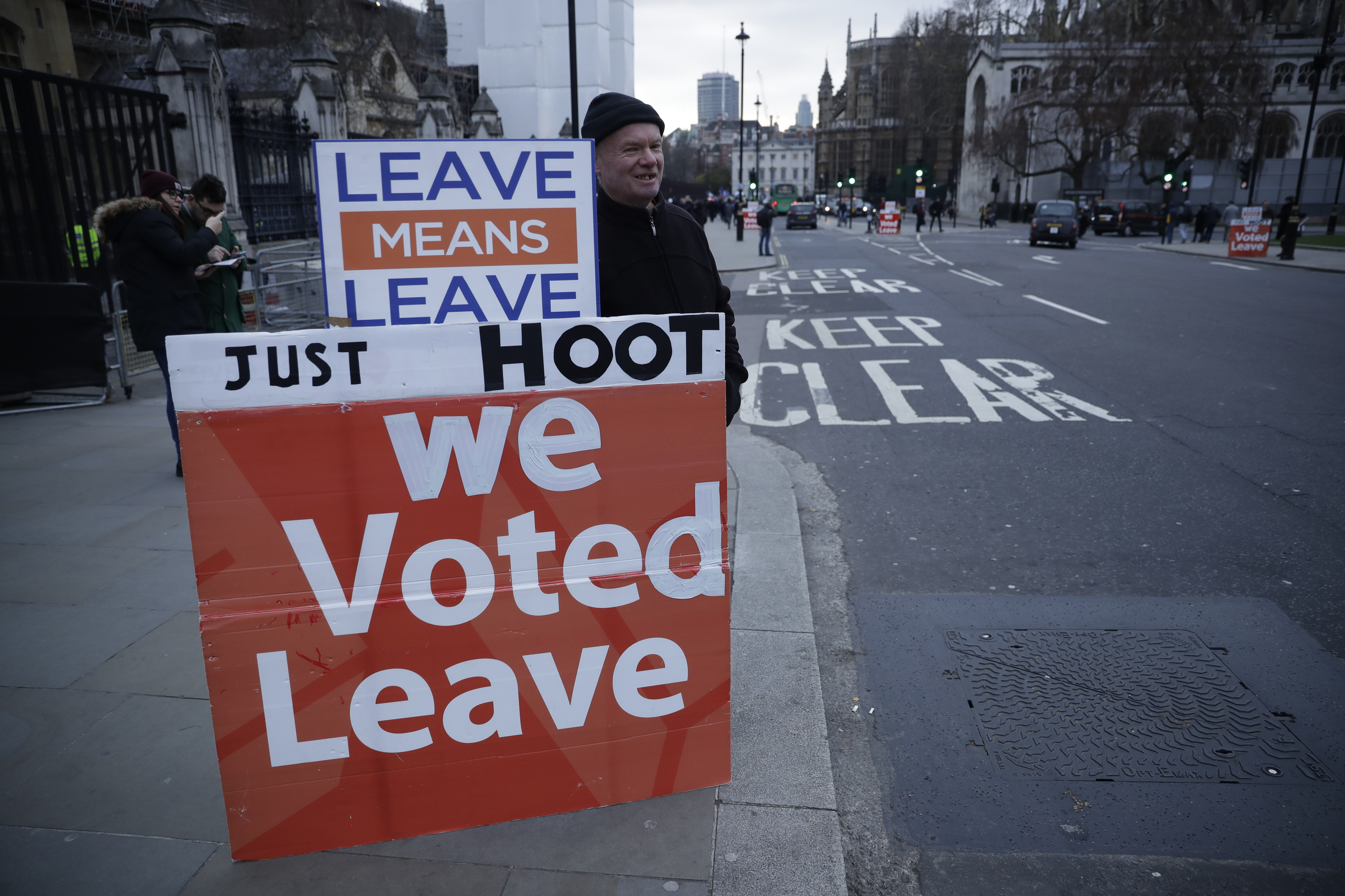 A pro-Brexit leave the European Union supporter demonstrates with placards outside the Houses of Parliament in London, Jan. 21, 2019.