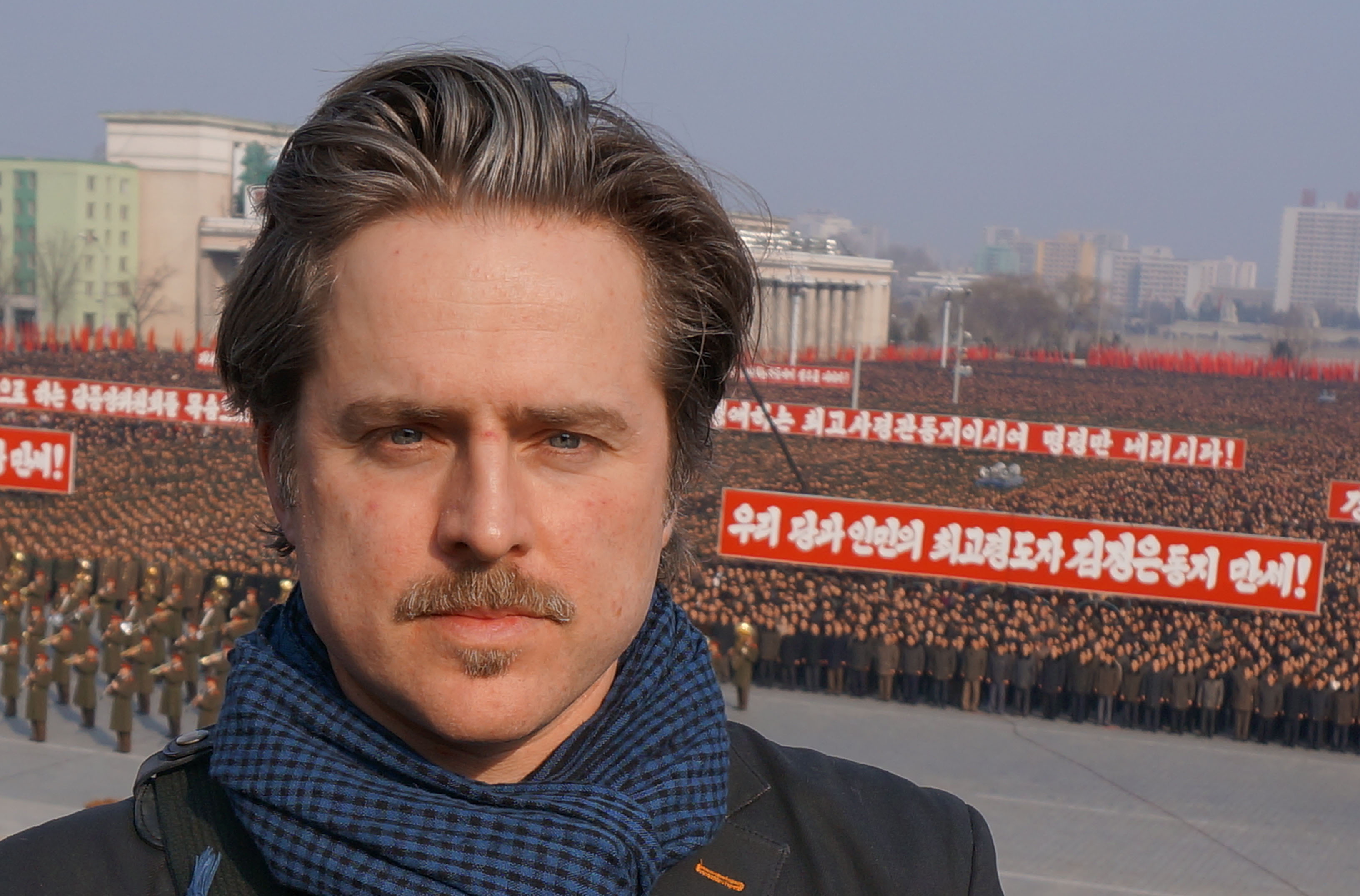 Norweigian Director Morten Traavik in front of a North Korean rally on Pyongyang's Kim Il Sung Square on March 7, 2013. The rally was in support of the government's announced cancellation of the 1953 Korean War cease-fire. in  on March 7, 2013. ...