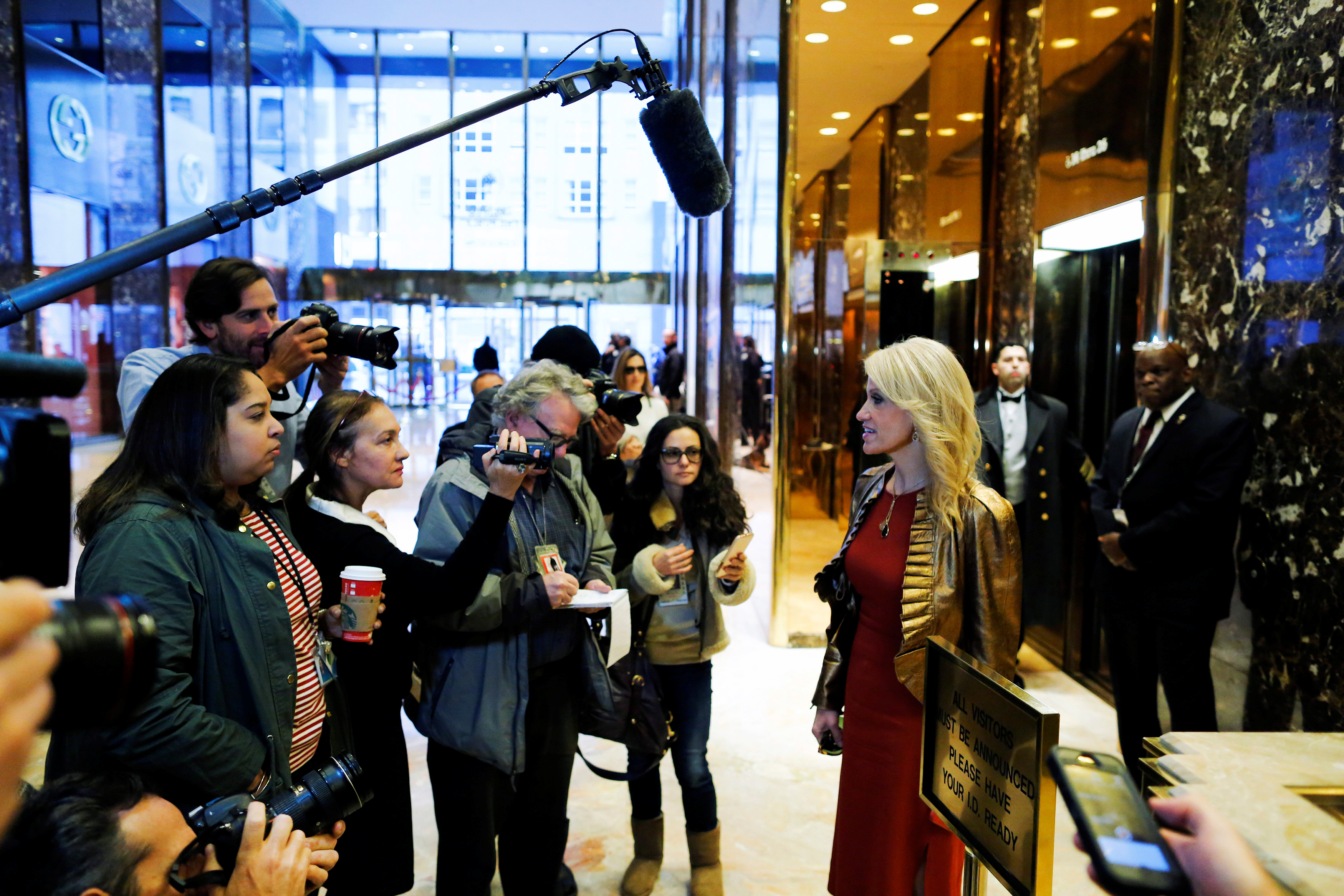 Campaign Manager Kellyanne Conway (R) speaks with reporters as she arrives at Republican president-elect Donald Trump's Trump Tower in New York,  Nov. 13, 2016.
