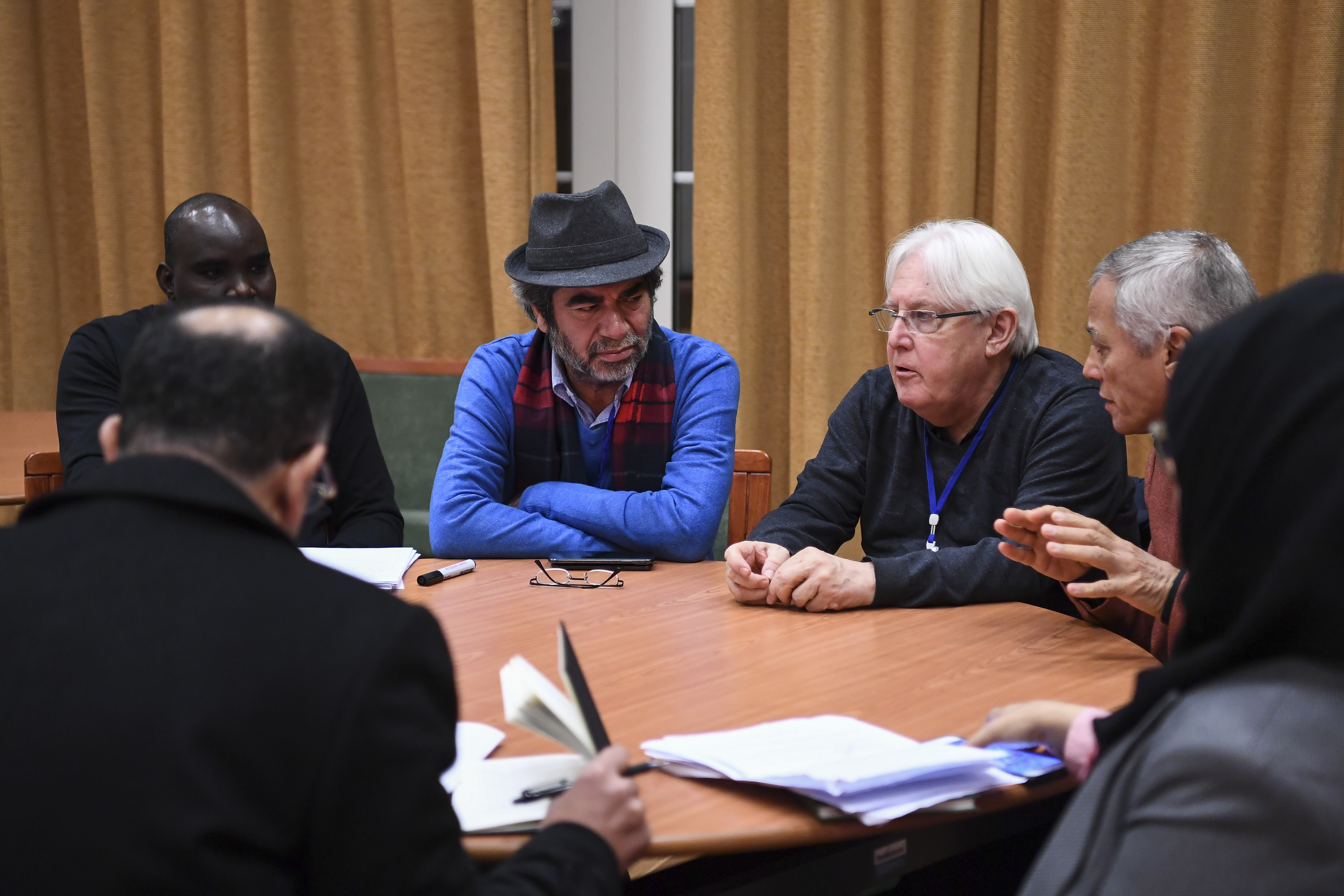 U.N. special envoy to Yemen Martin Griffiths, third right, takes part in a work group with a member of a Yemeni government's delegation, Abdulaziz Jabari, not pictured, and with a rebel delegation member Salim al-Moughaless, not pictured, as part of ...