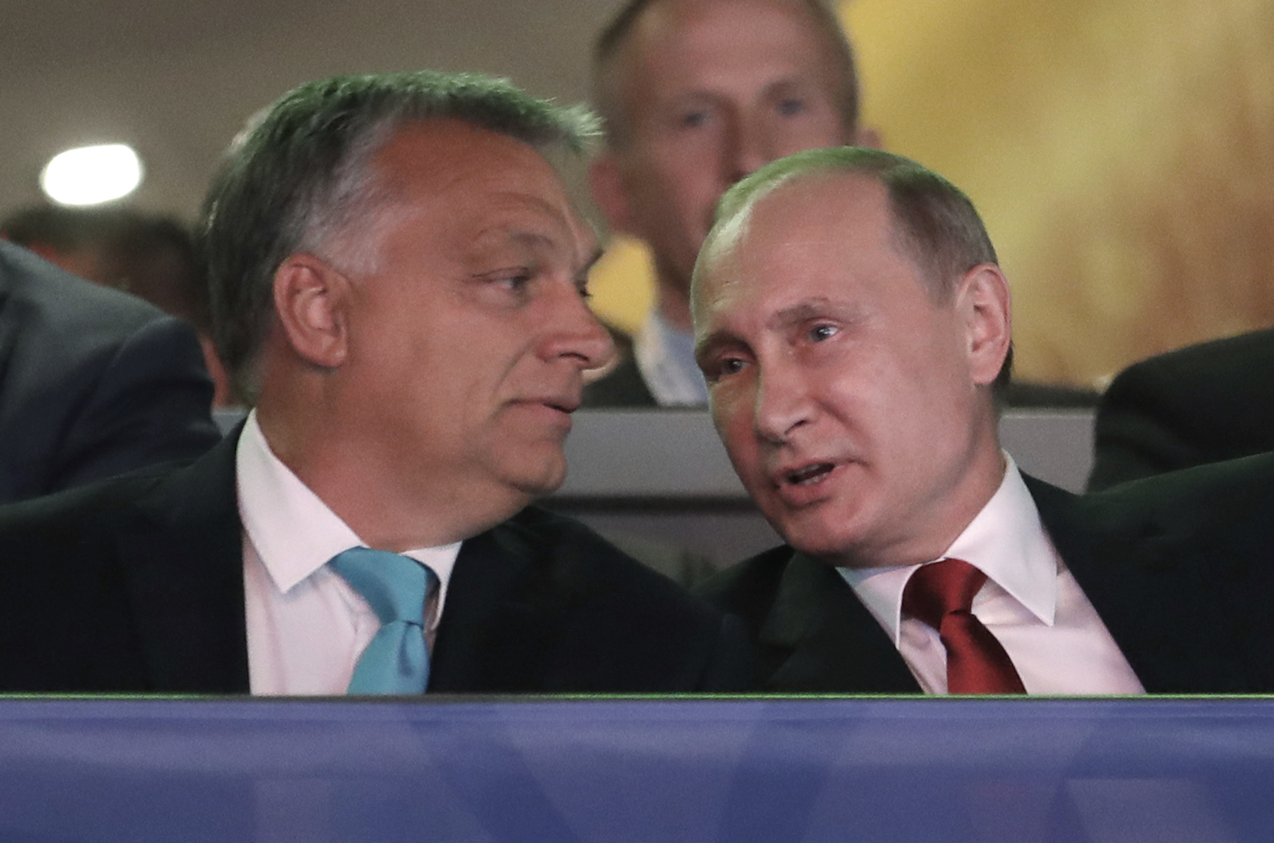 Russian President Vladimir Putin, right, talks to Hungarian Prime Minister Viktor Orban after arriving at the World Judo Championships in Budapest, Hungary, Aug. 28, 2017.
