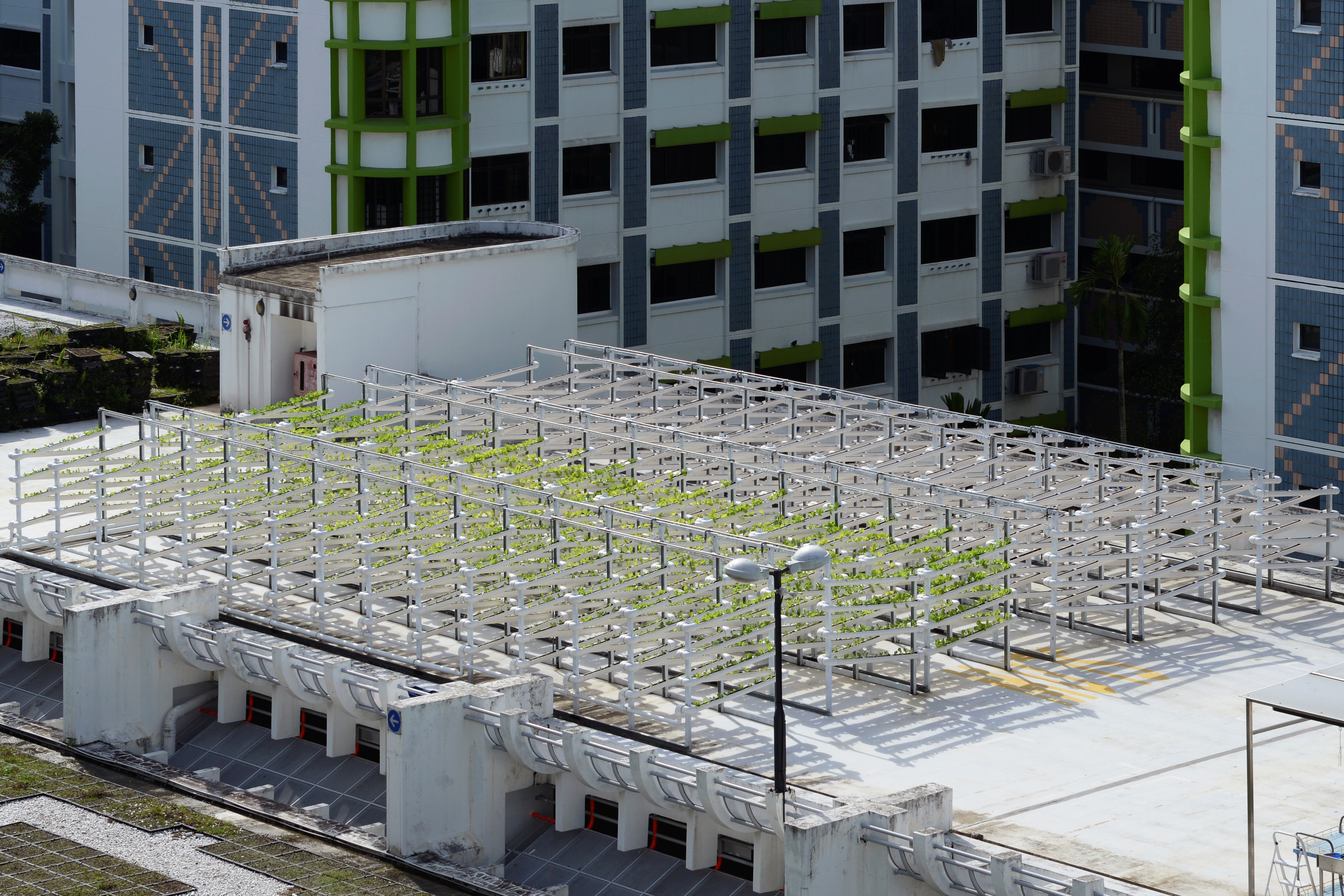 An aerial view shows Citiponics' urban farm located on the rooftop of a multi-story garage in a public housing estate in western Singapore, April 17, 2018.