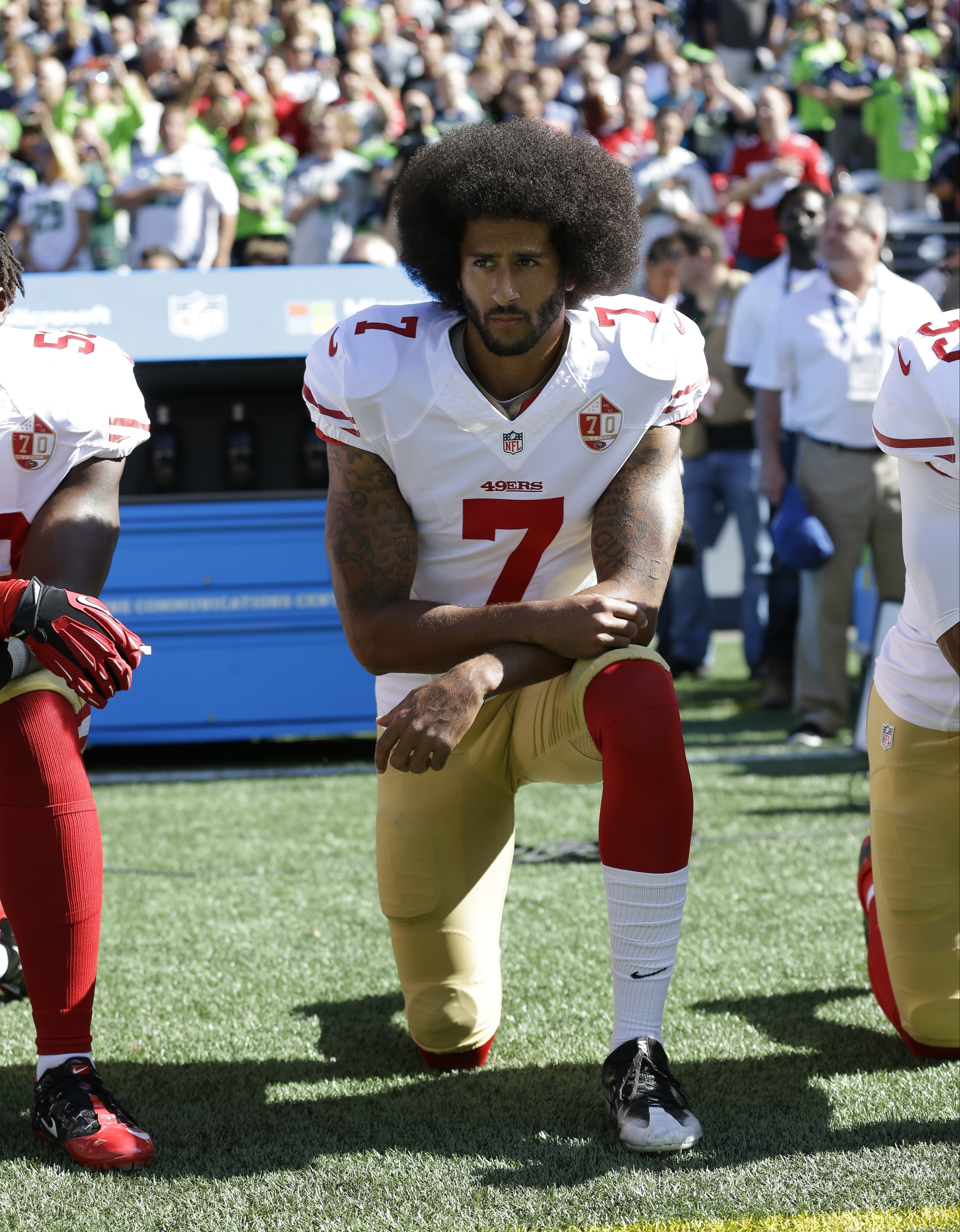 FILE - San Francisco 49ers' Colin Kaepernick kneels during the national anthem before an NFL football game against the Seattle Seahawks, in Seattle, Washington, Sept. 25, 2016. (