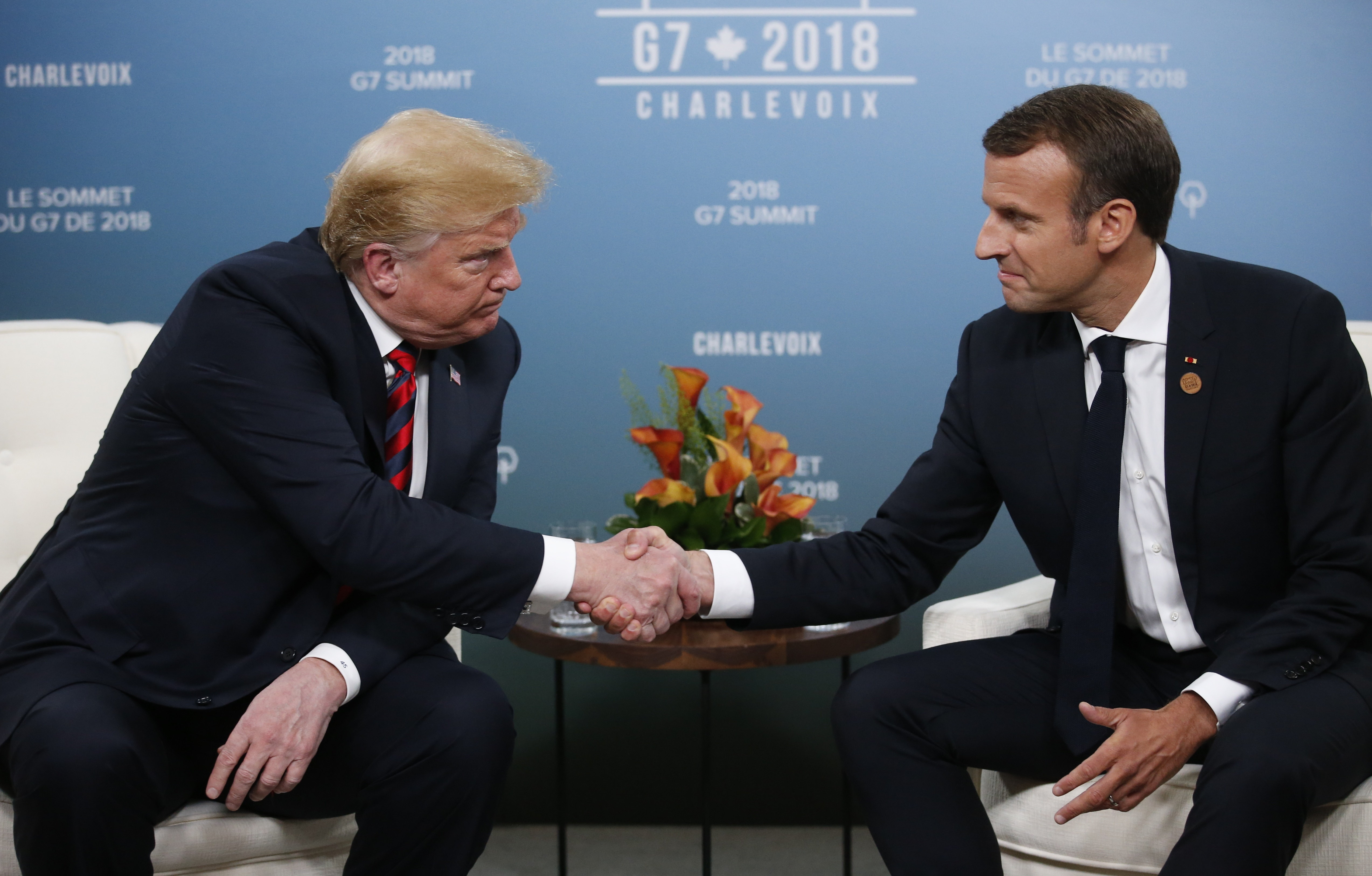 U.S. President Donald Trump shakes hands with France's President Emmanuel Macron during a bilateral meeting at the G7 Summit in in Charlevoix, Quebec, Canada,