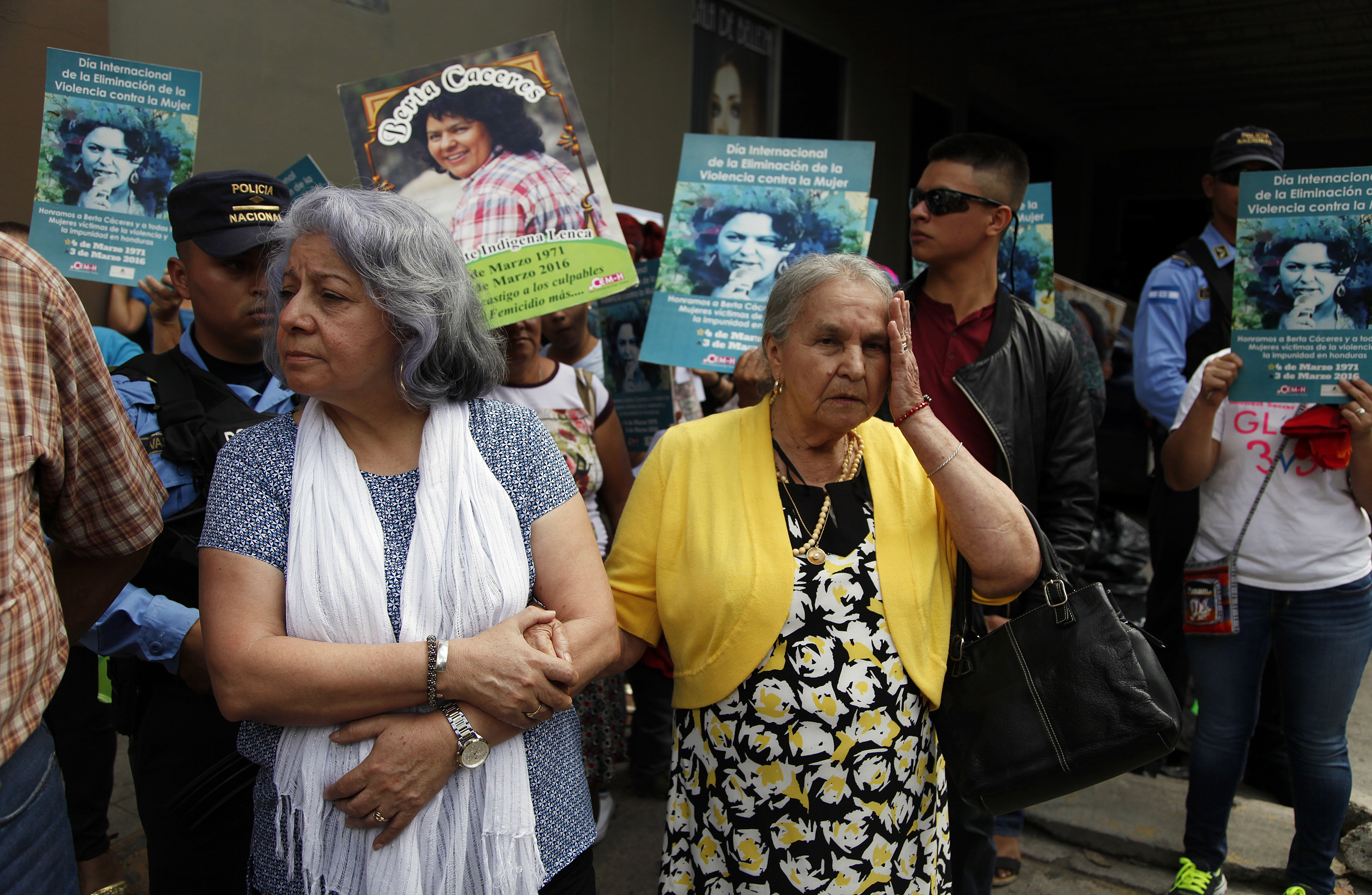 Honduran human rights defender Bertha Oliva, left, stands arm in arm with Austra Bertha Flores, the mother of slain environmental activist and Goldman Environmental Prize winner Berta Caceres, during a protest demanding justice for Caceres, outside t...