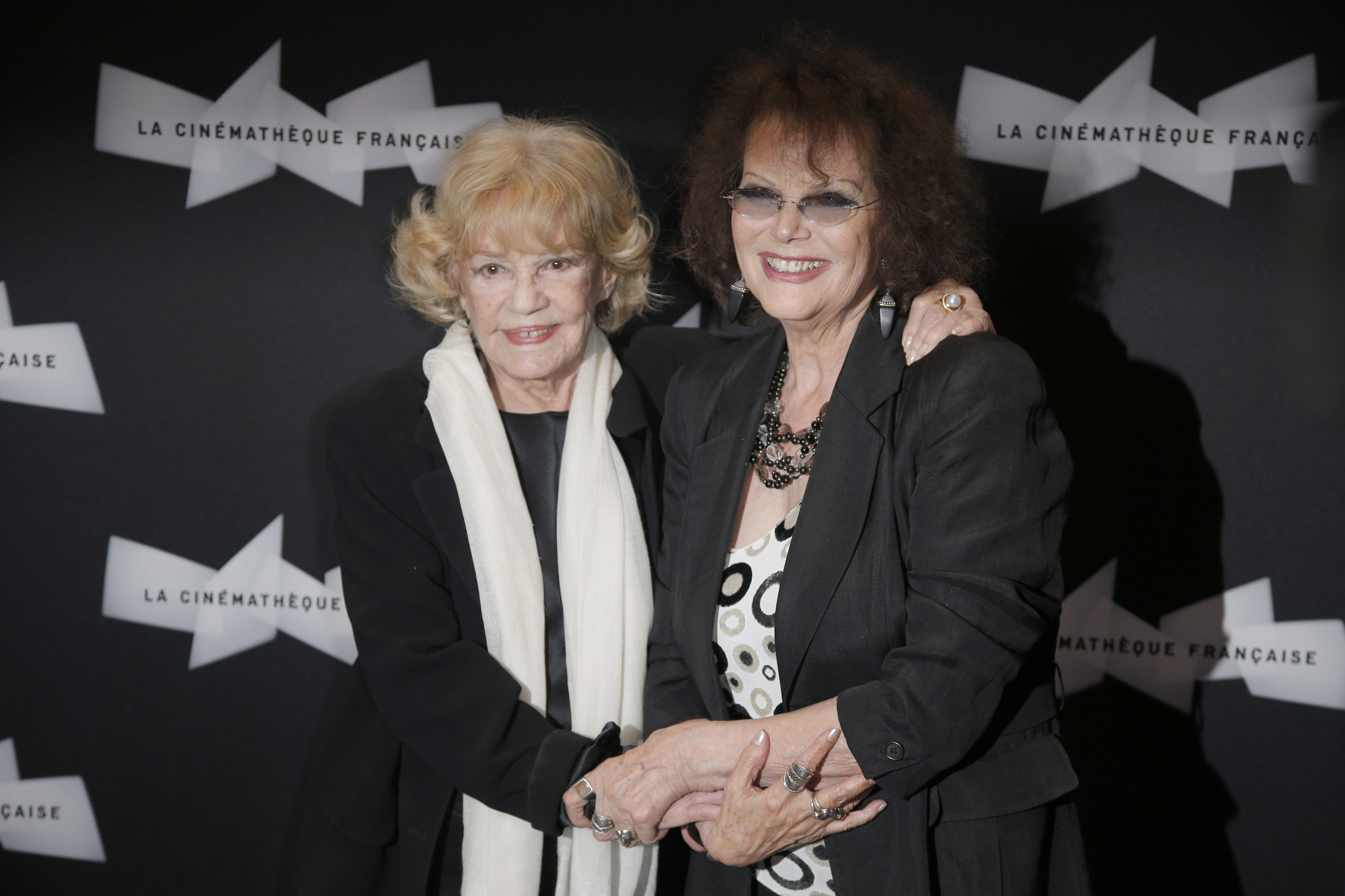 "FILE - French actress Jeanne Moreau, left, and Italian actress Claudia Cardinale arrive for the screening of ""Gebo et l'Ombre,"" of Portuguese director Manoel de Oliveira at the Cinematheque Francaise, in Paris, Sept. 6, 2012."