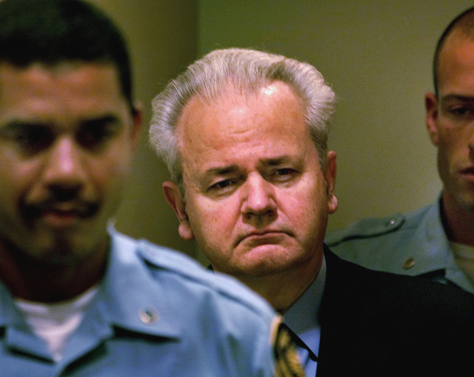 Slobodan Milosevic, center, enters the courtroom to appear before the court of the International Criminal Tribunal for the former Yugoslavia in The Hague, the Netherlands, Dec. 11, 2001.