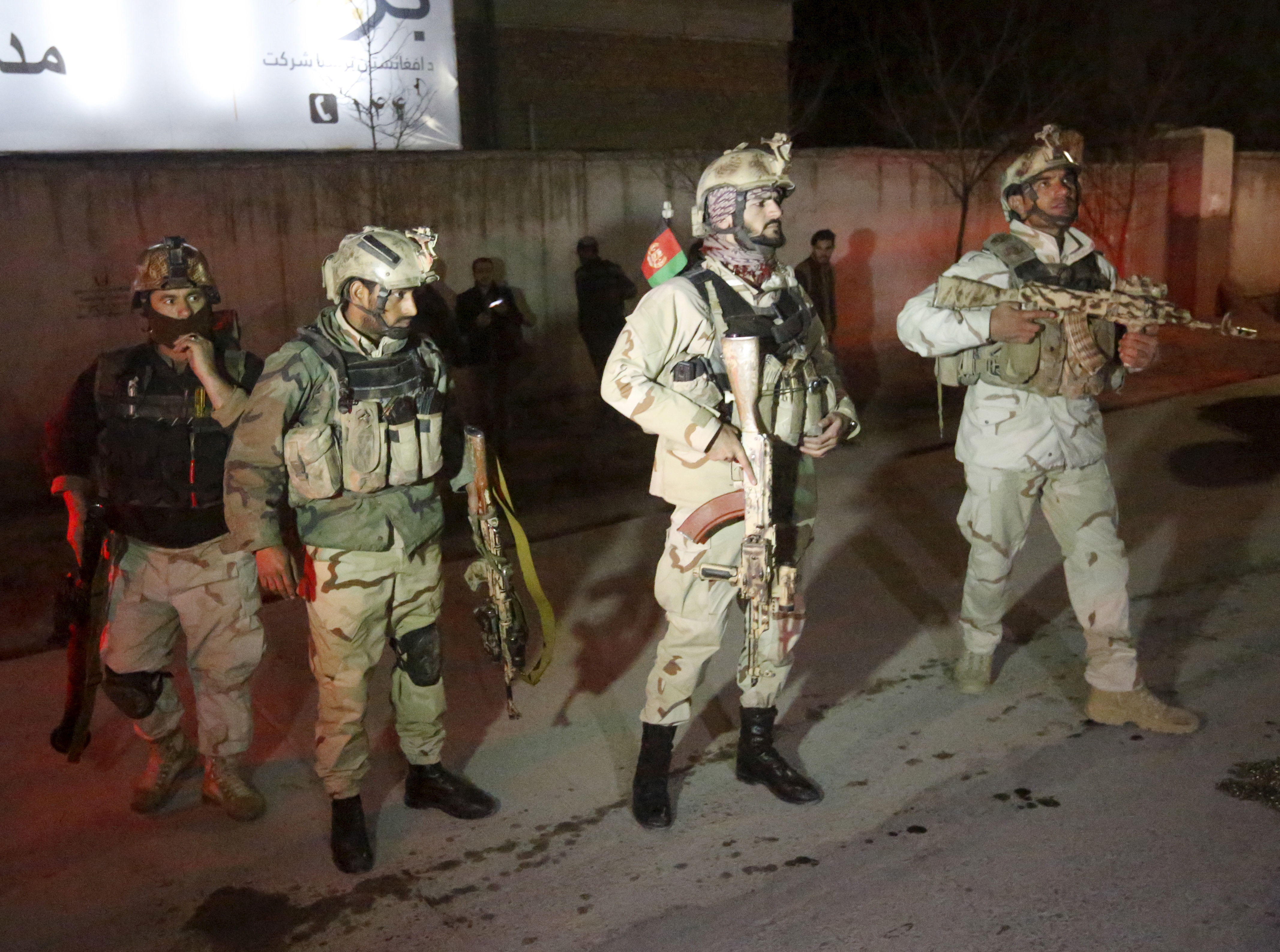 Members of Afghan Crisis Response Unit (CRU) arrive at the site of a Taliban attack in the Afghan capital of Kabul, Afghanistan, Dec. 11, 2015.