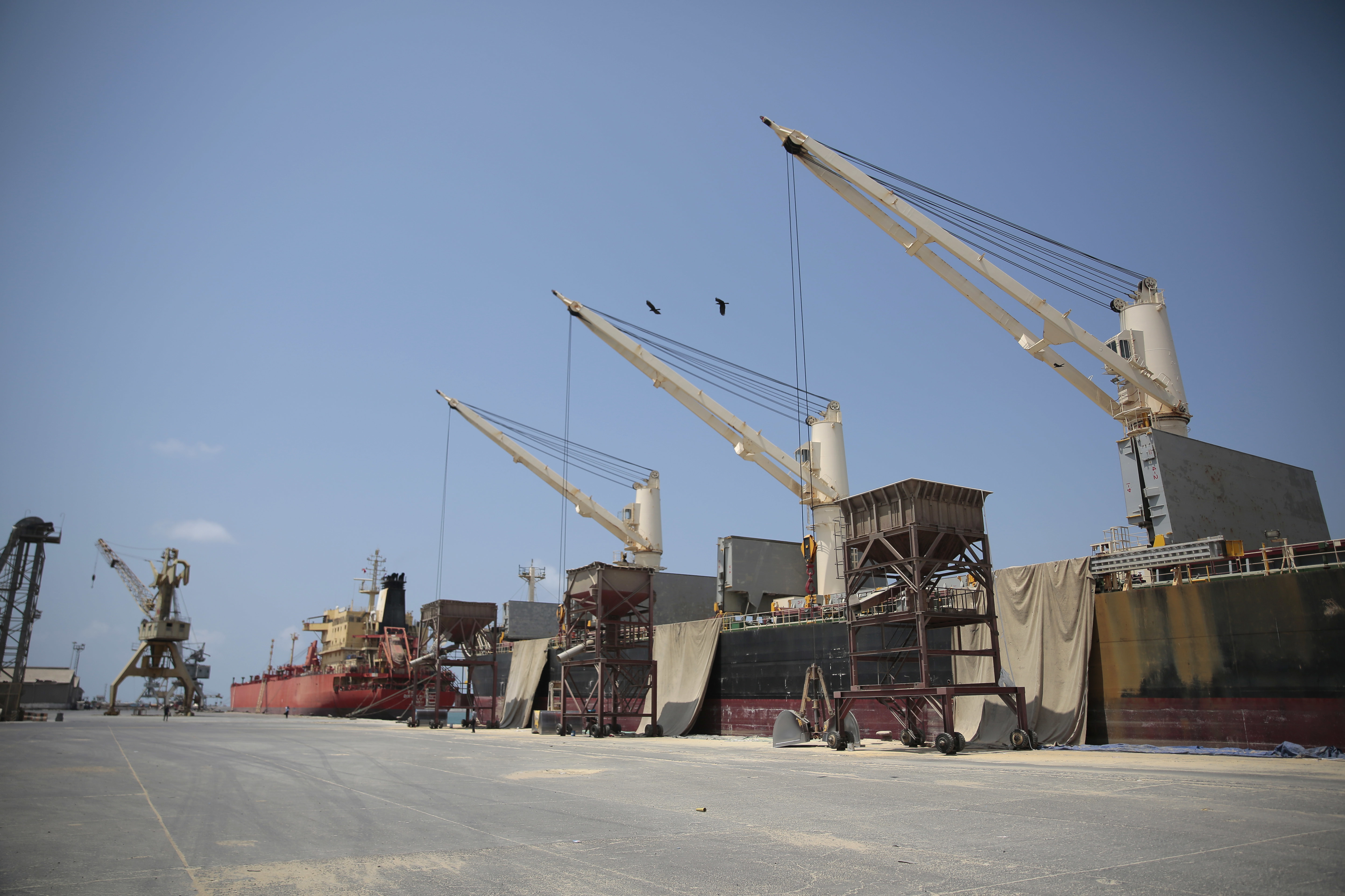 FILE - Cargo ship and oil tanker ship are idle at the port of Hodeida, Yemen, Sept. 29, 2018.