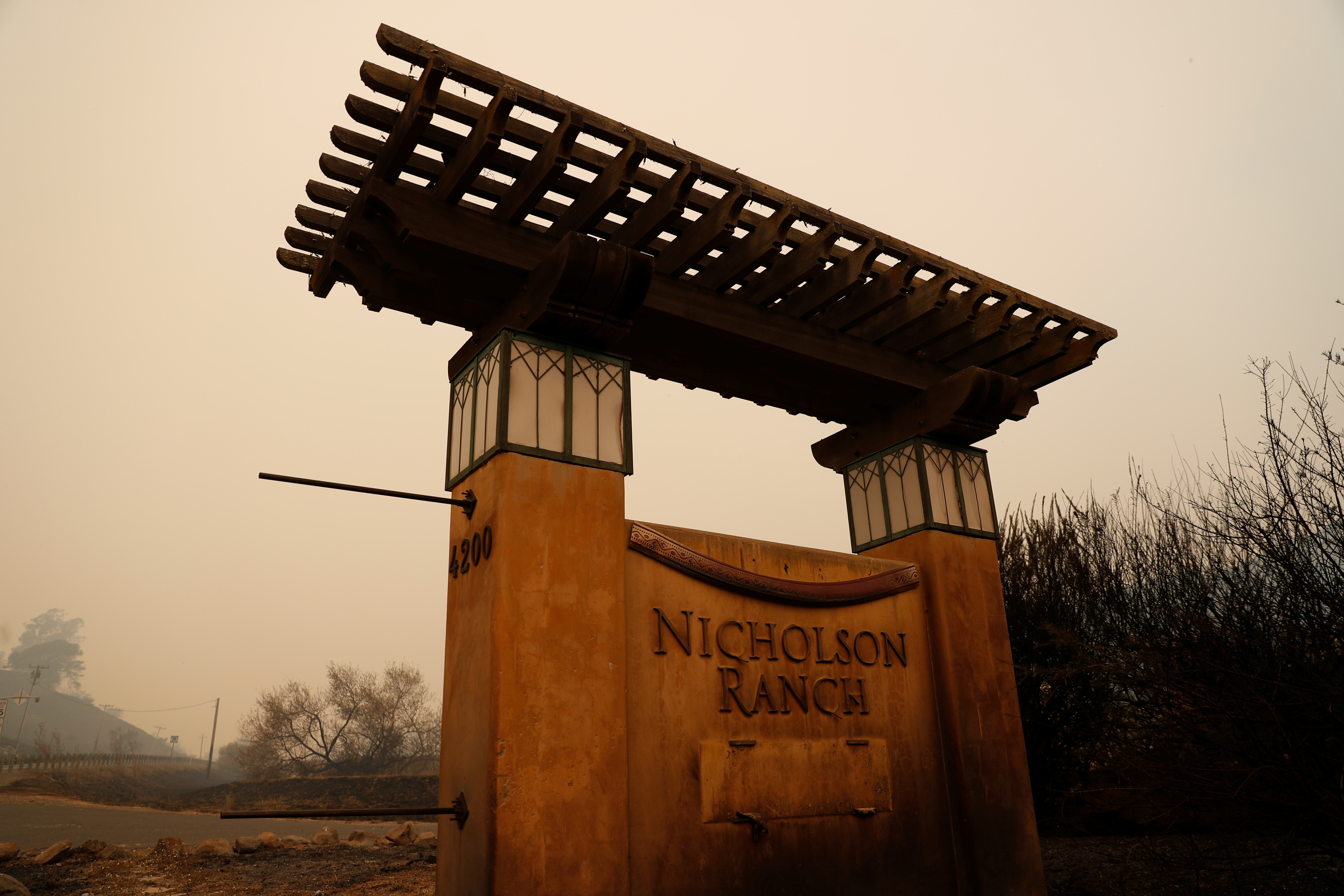 A charred entrance to the Nicholson Vineyards and Winery damaged by the Partrick Fire is seen in Sonoma, California, Oct. 11, 2017.