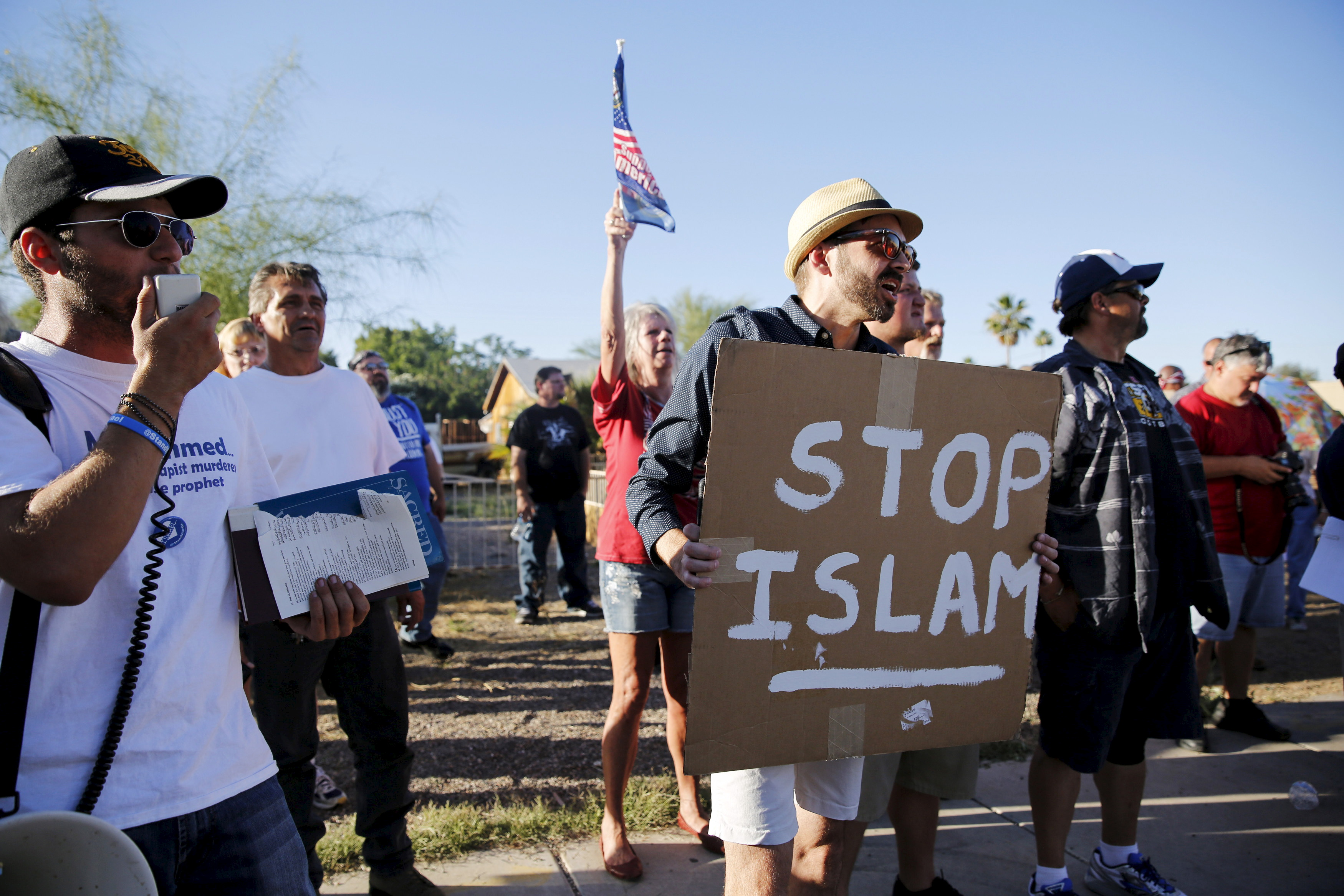 "FILE - Demonstrators shout during a ""Freedom of Speech Rally Round II"" outside the Islamic Community Center in Phoenix, Arizona, May 29, 2015."