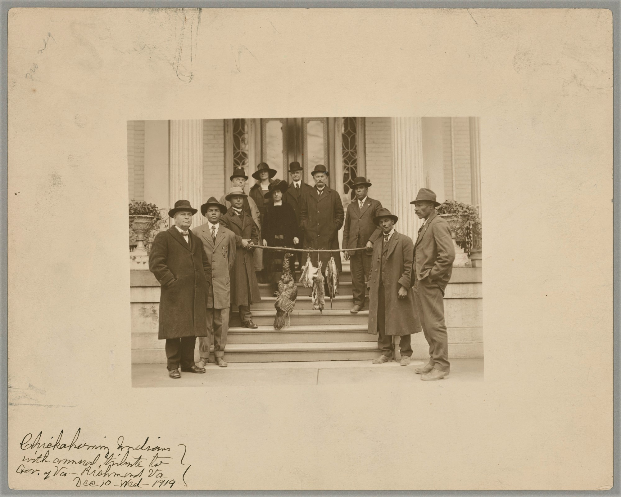 Chickahominy tribe paying annual tribute of game animals to Virginia governor, Dec. 10, 1919, a ceremony still observed today. Then-chief Ozias Westmore Adkins (third from left) served as chief from 1918 until his death in 1939.  BAE 1-9 01787700, Na...
