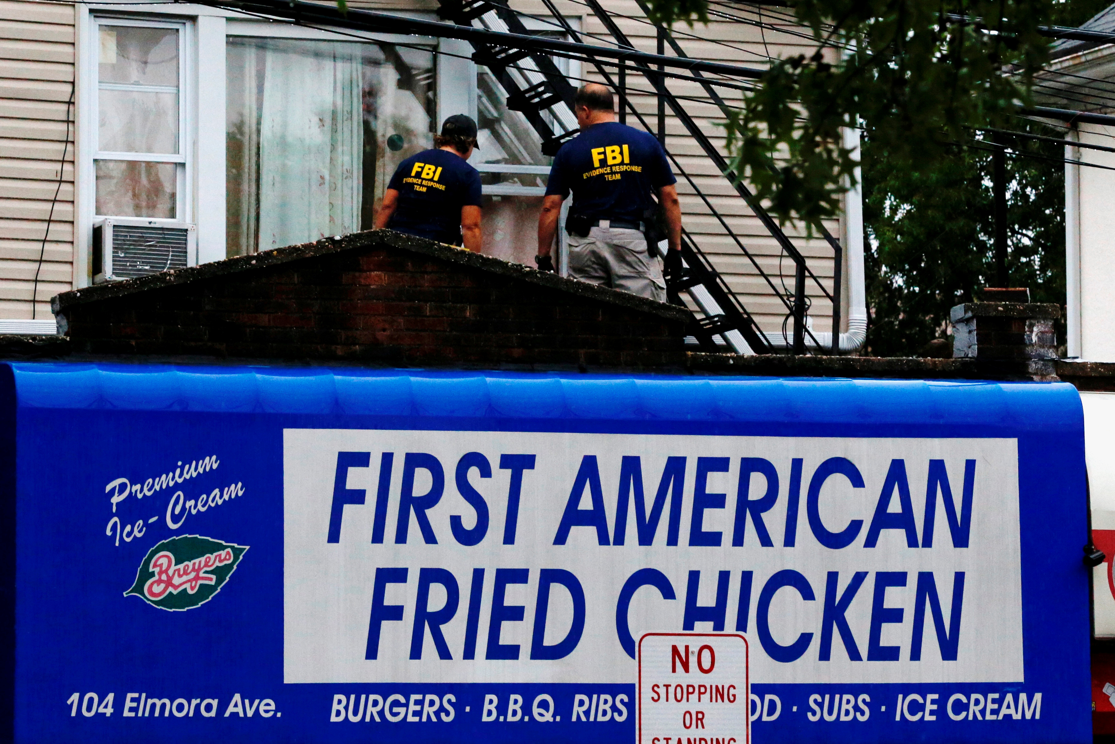 Federal Bureau of Investigation personnel search an address during an investigation into Ahmad Khan Rahami, who was wanted for questioning in an explosion in New York, which authorities believe is linked to the explosive devices found in New Jersey, ...