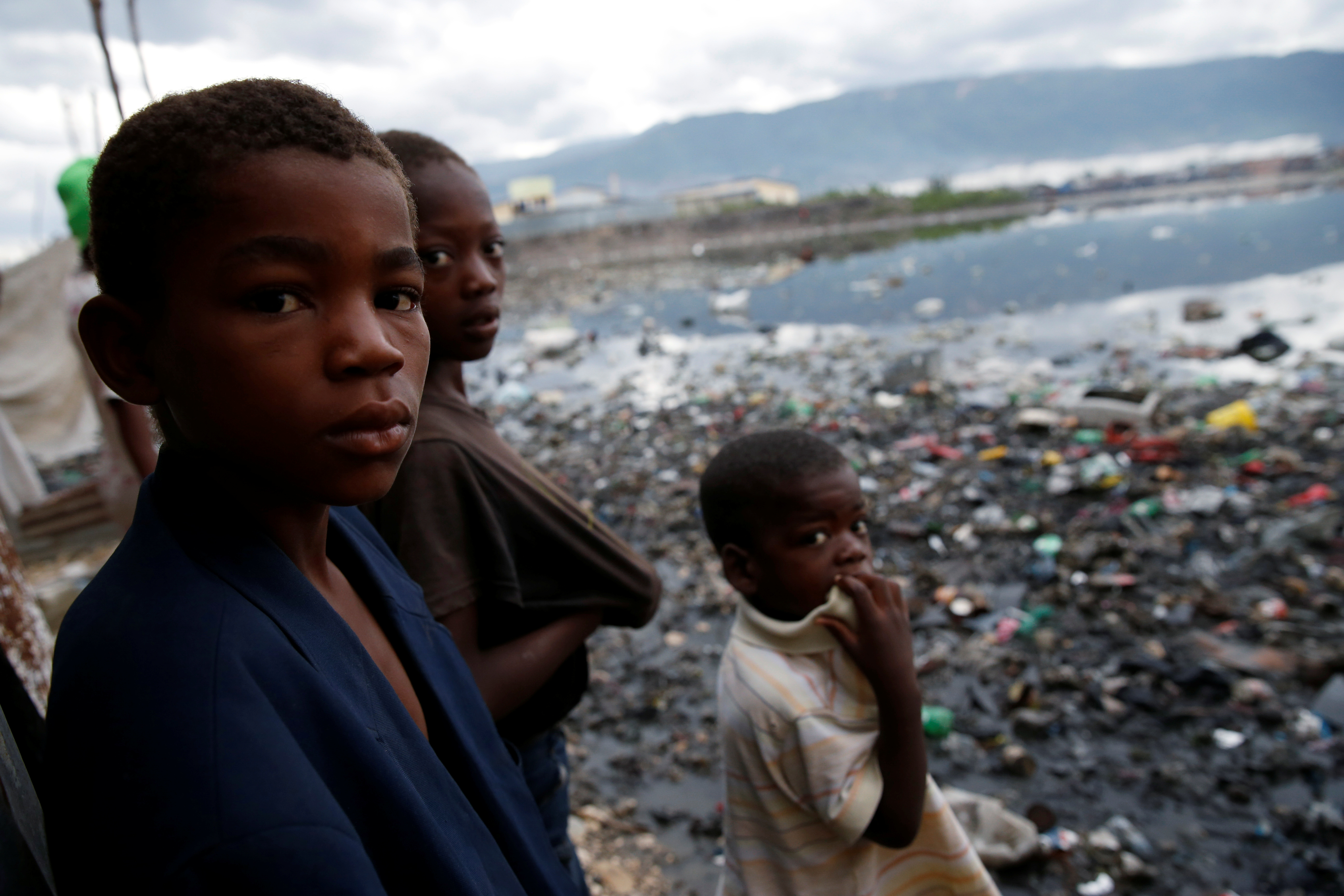 Children stand next to a flooded area after Hurricane Matthew passes Cite-Soleil in Port-au-Prince, Haiti, Oct. 5, 2016.
