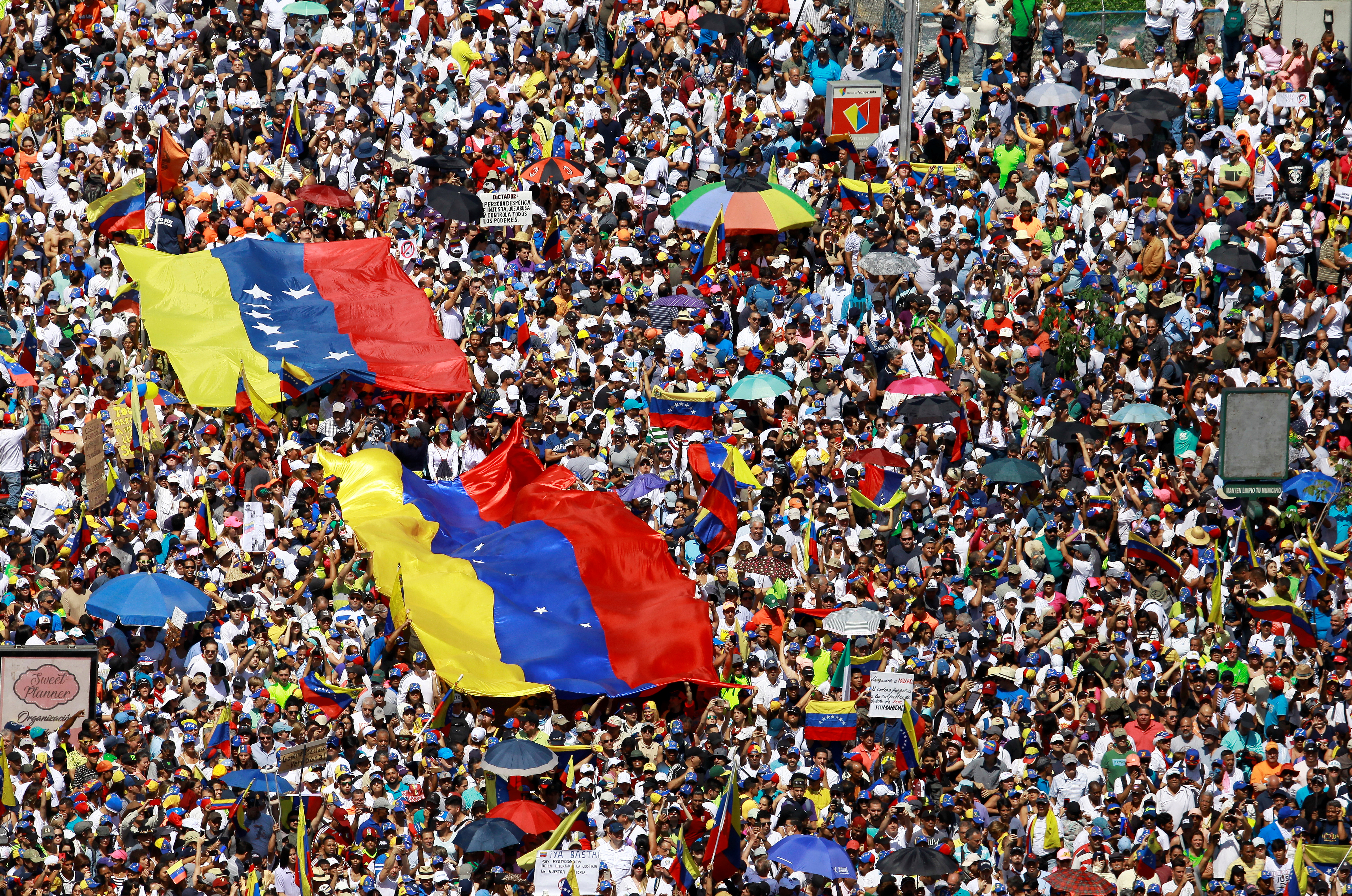 Opposition supporters take part in a rally against Venezuelan President Nicolas Maduro's government in Caracas, Venezuela, Feb. 2, 2019.