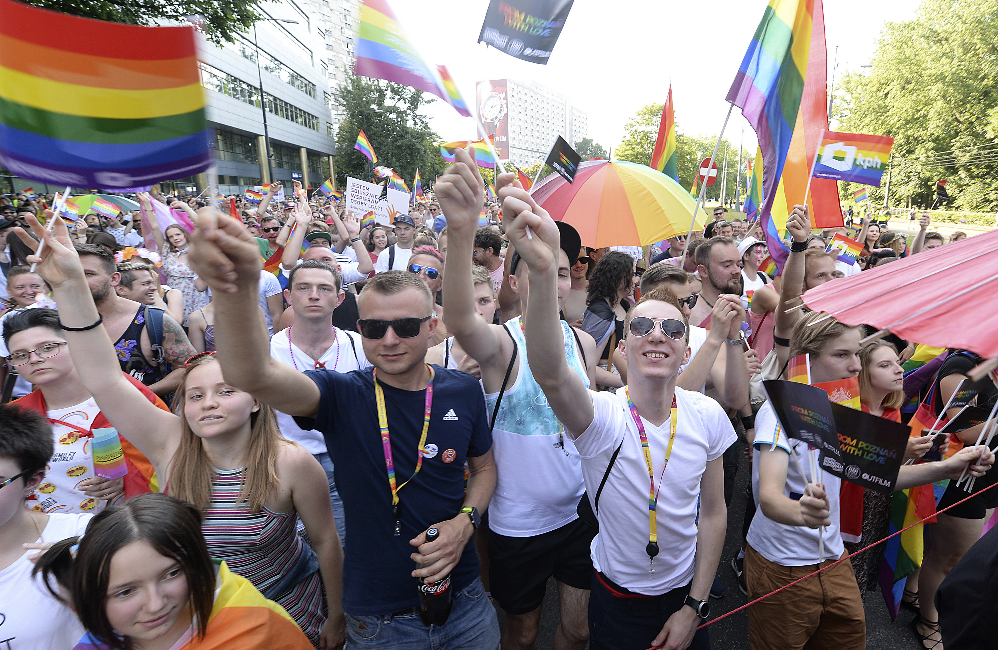 People take part in a gay pride parade in Warsaw, Poland, June 9, 2018. The pride celebrations come as LGBTQ activists say a conservative turn in Poland is only motivating them to fight harder for their rights.