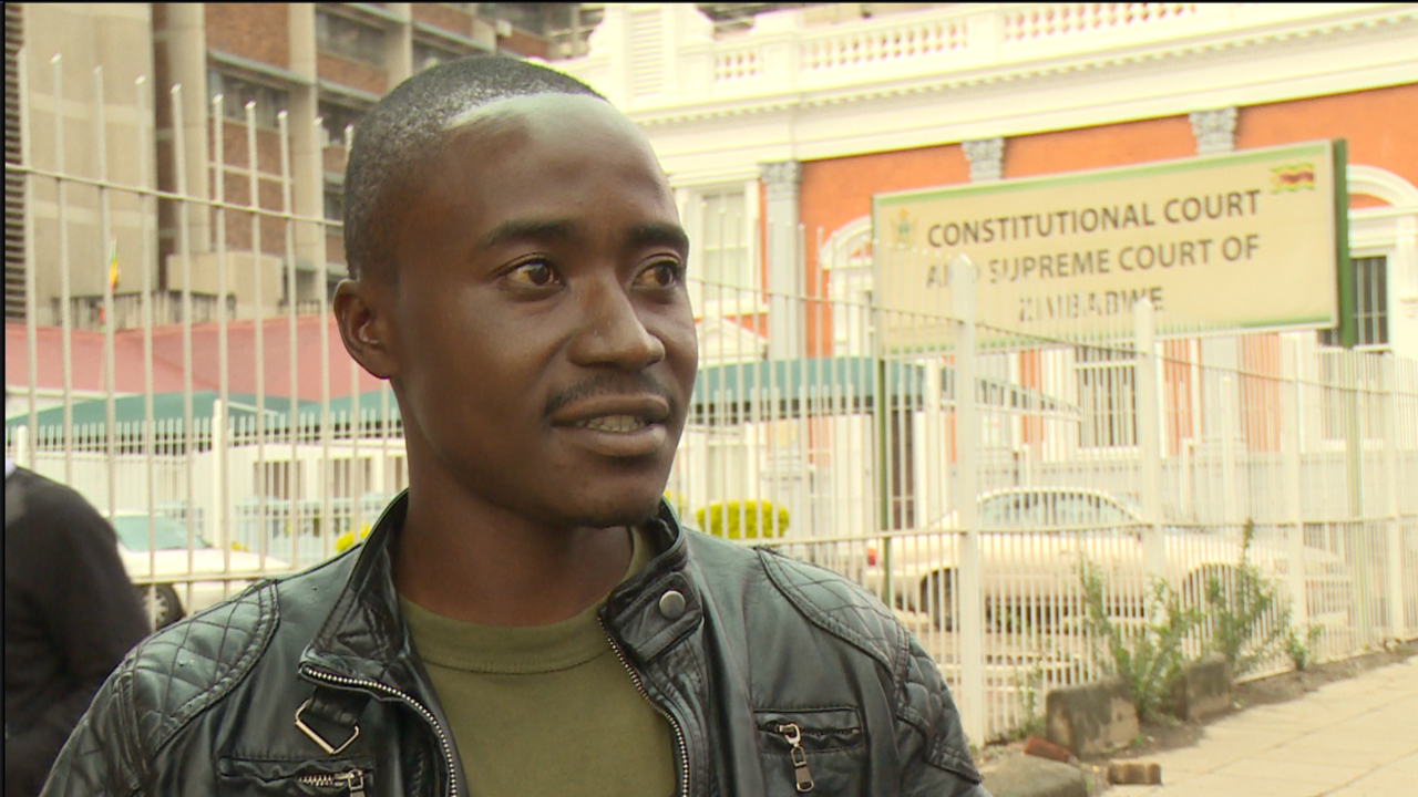 Adrian Manjere has an arm which was fractured by a stray bullet from an AK-47 on August 1, according to a medical report. He says he's spent about $11,000 for medical treatment.
