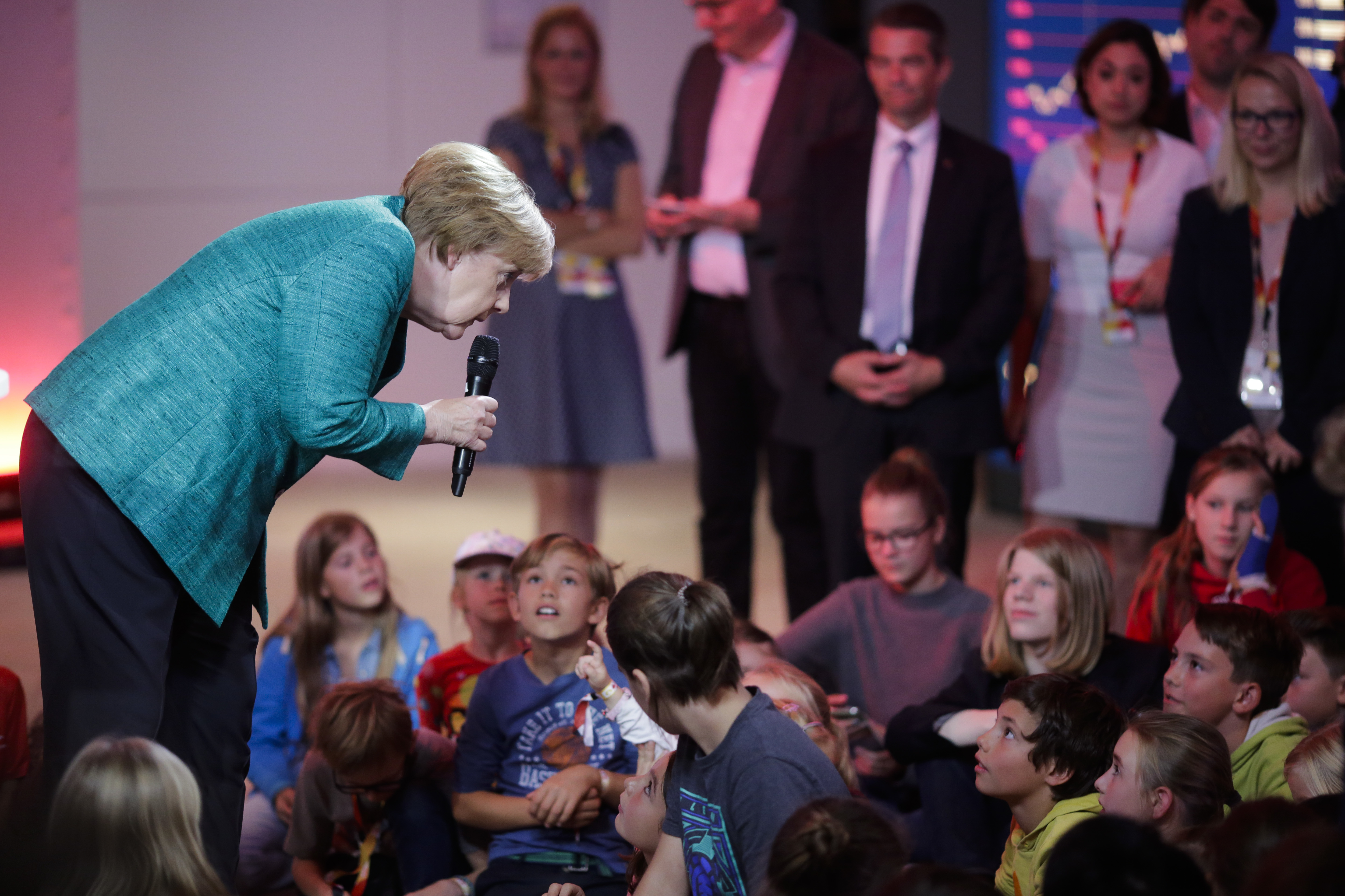 German Chancellor Angela Merkel, left, attends a news conference for children during a family event of her Christian Democratic Union party in Berlin,  Sept. 17, 2017.