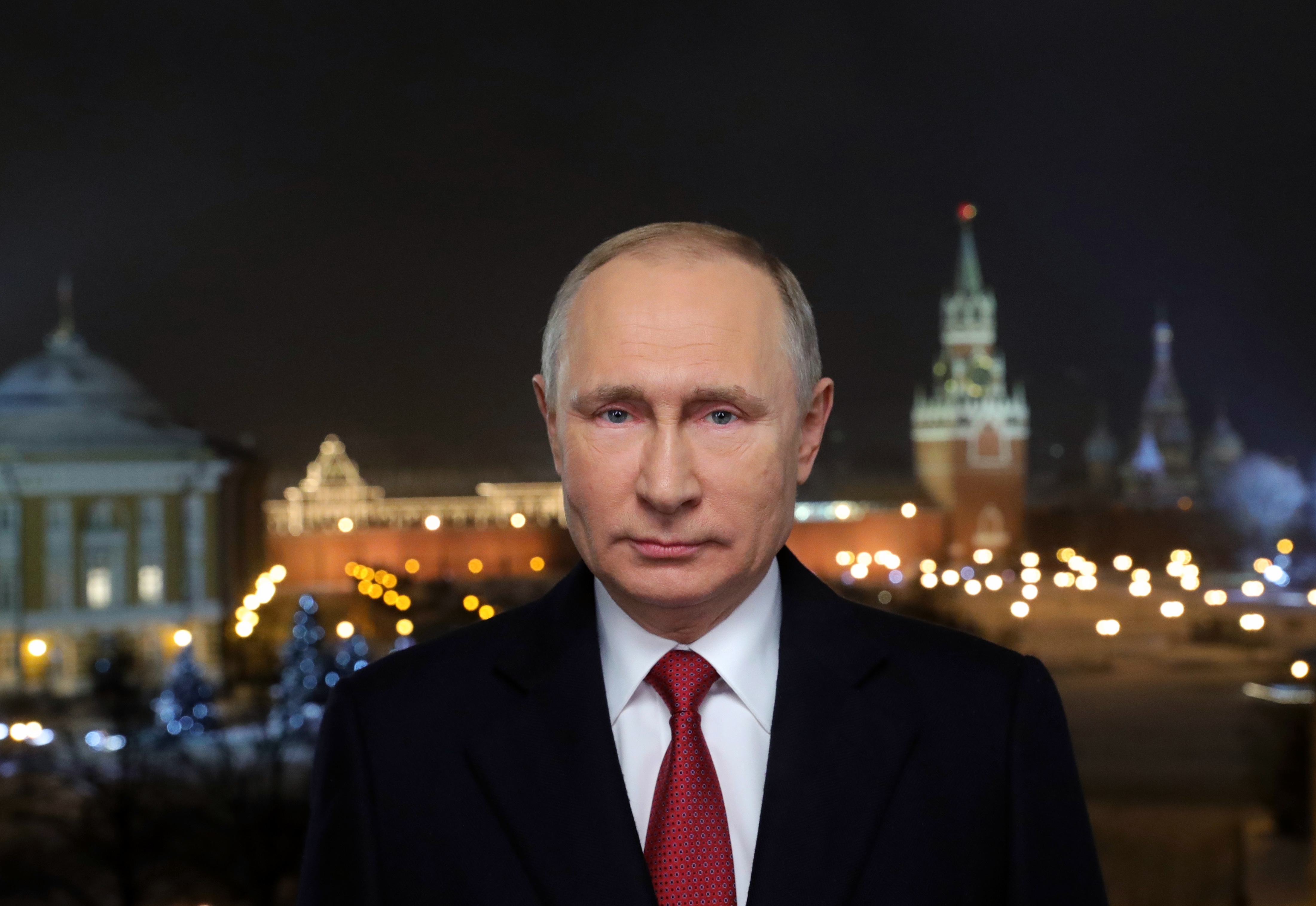 In this photo released by Kremlin Press service via Sputnik agency, Russian President Vladimir Putin speaks during a recording of his annual televised New Year's message in the Kremlin in Moscow, Jan. 31, 2018.