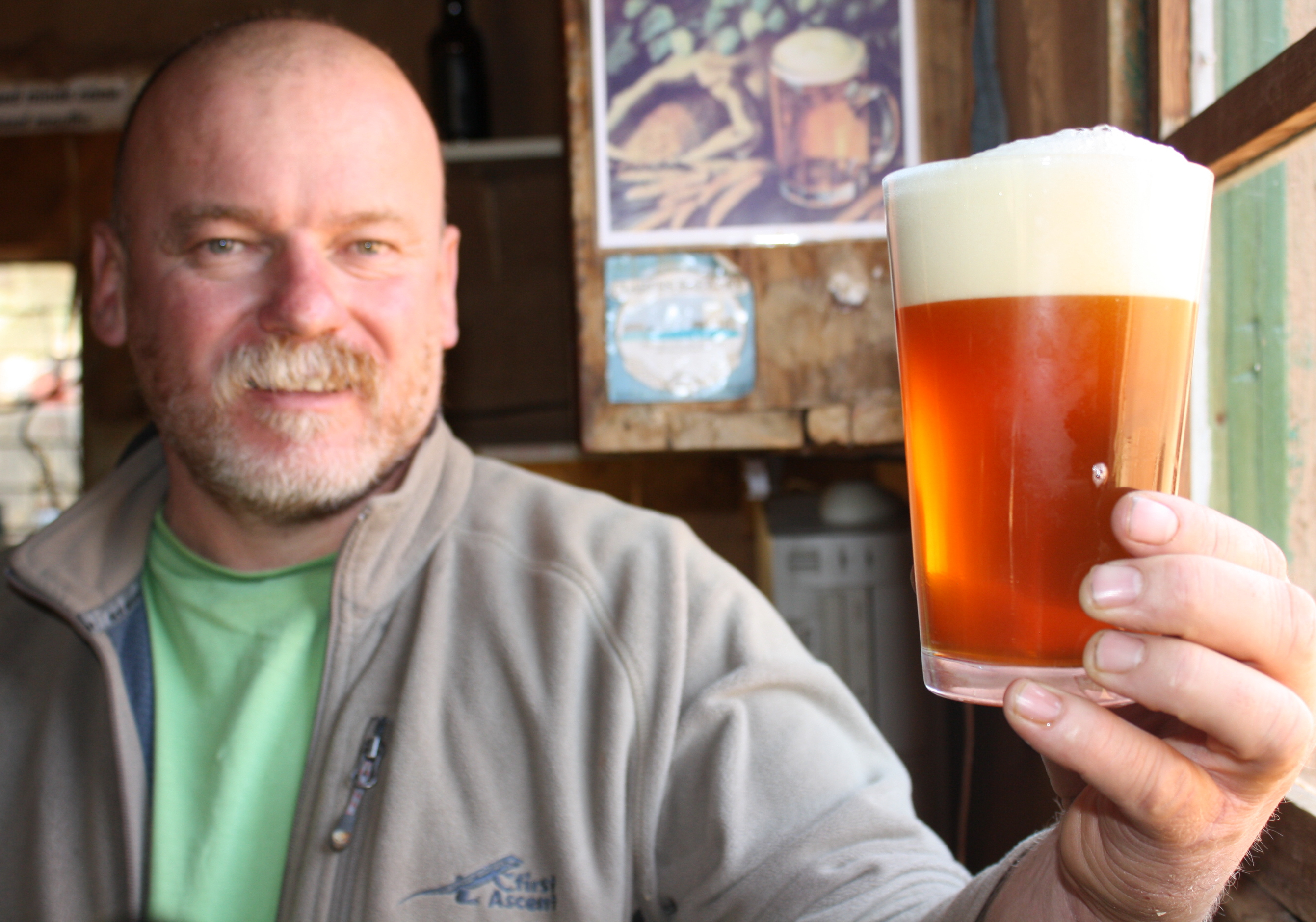 Dirk van Tonder of South Africa admires a freshly poured 'African pale ale' that he brewed using the J-17-63 hop (VOA/Darren Taylor)