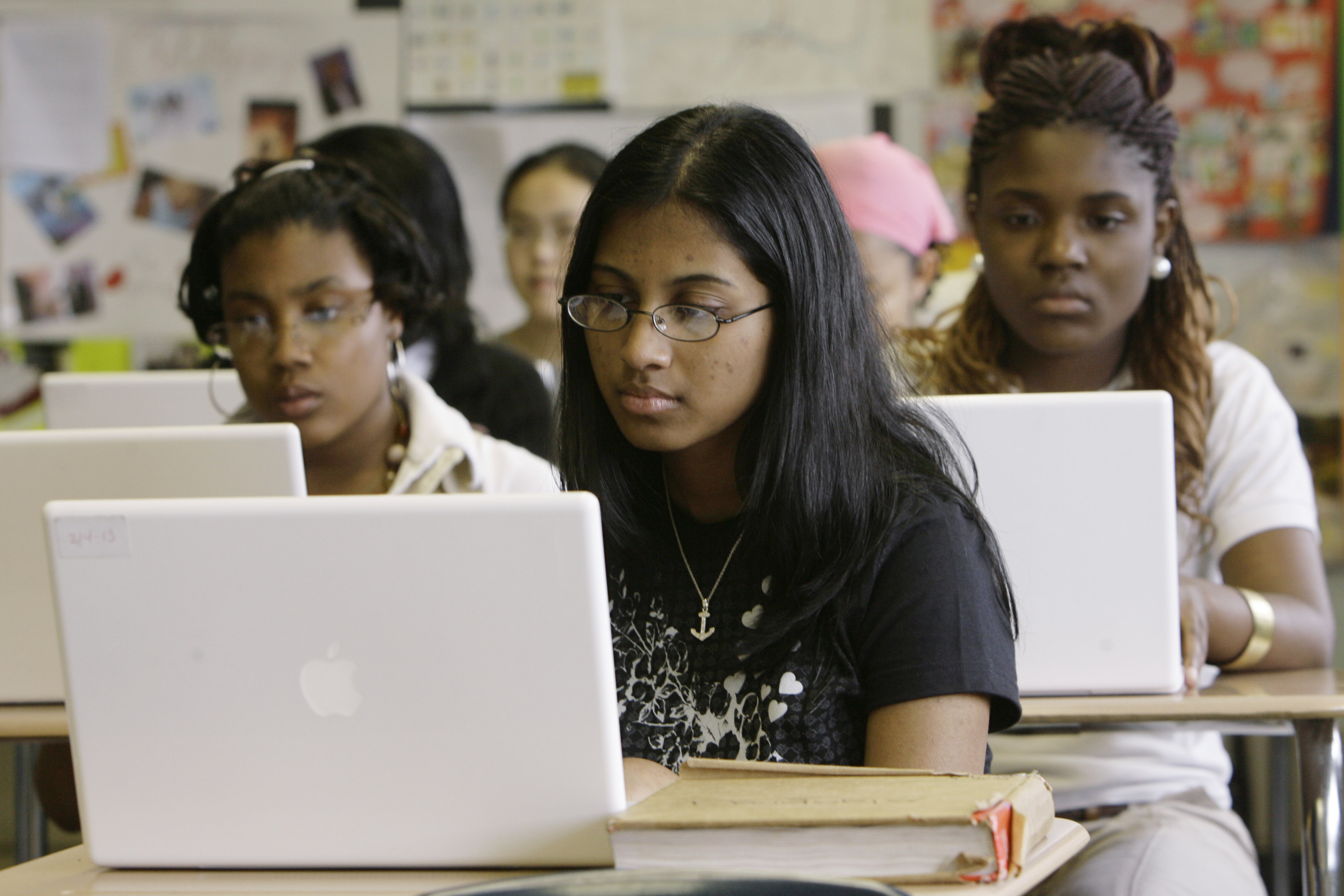 FILE - Ninth-graders work on laptop computers during a class at the Philadelphia High School for Girls in Philadelphia.