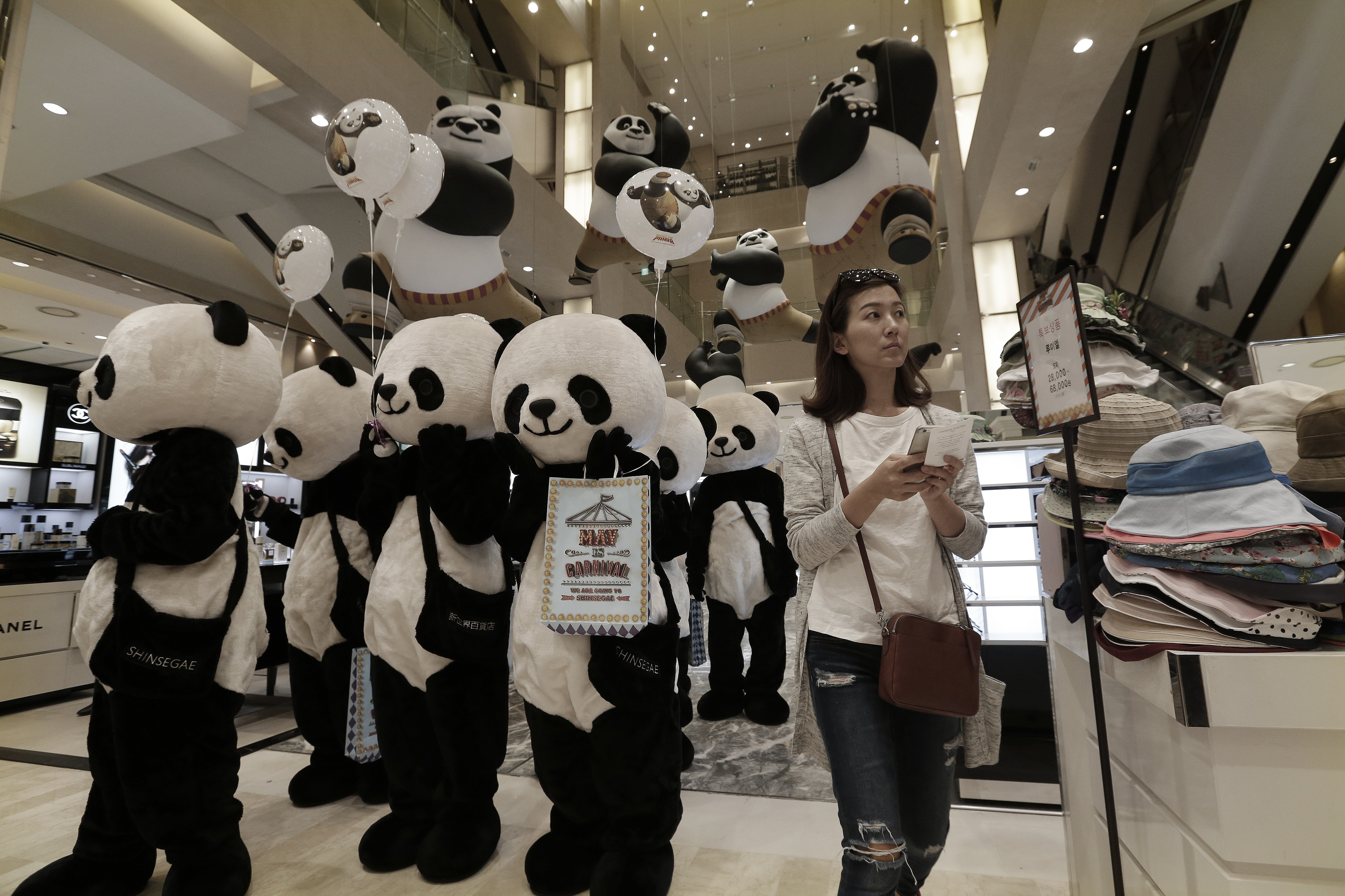 Workers wearing panda costumes attend a promotion event for Chinese tourists at a department store in Seoul, South Korea, Thursday, April 28, 2016.