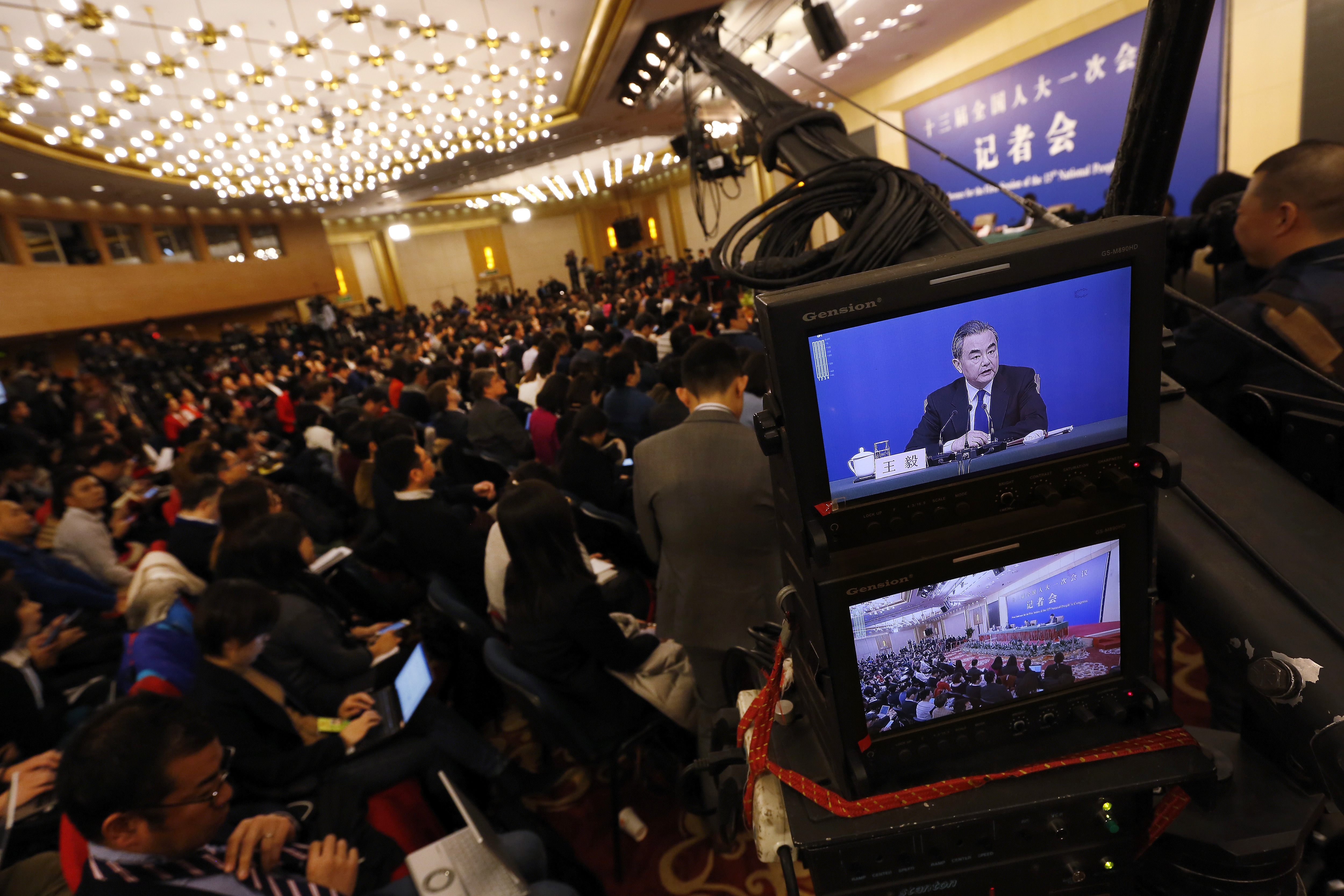 A camera screen shows China's Foreign Minister Wang Yi speaking during a press conference on the sidelines of the National People's Congress at the media center in Beijing, March 8, 2018.