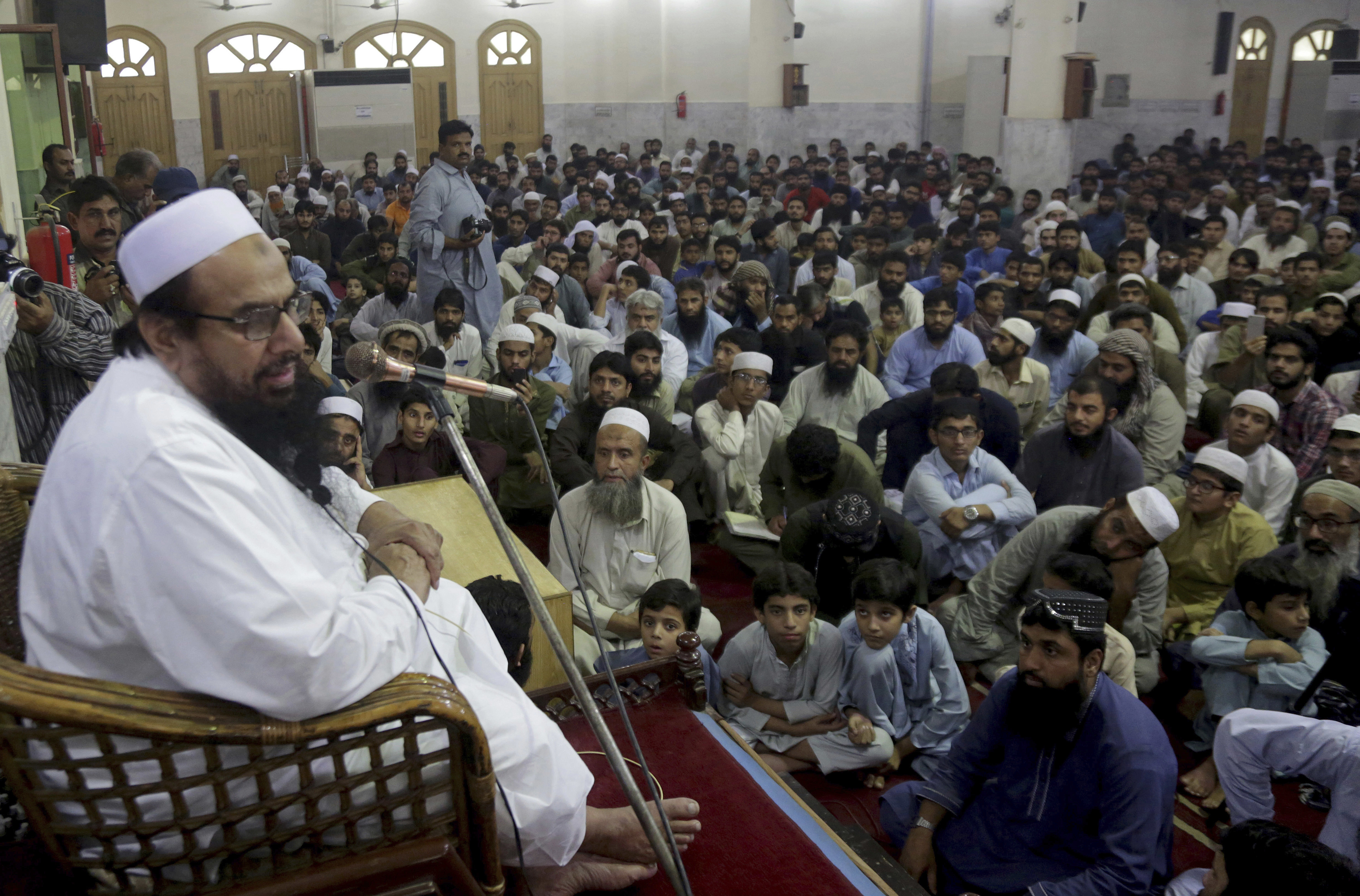 FILE - Pakistani cleric Hafiz Saeed, the founder of the outlawed Lashkar-e-Taiba group, which was blamed for the 2008 Mumbai attacks that killed 166 people, addresses at a mosque in Lahore, Pakistan, Nov. 1, 2018.