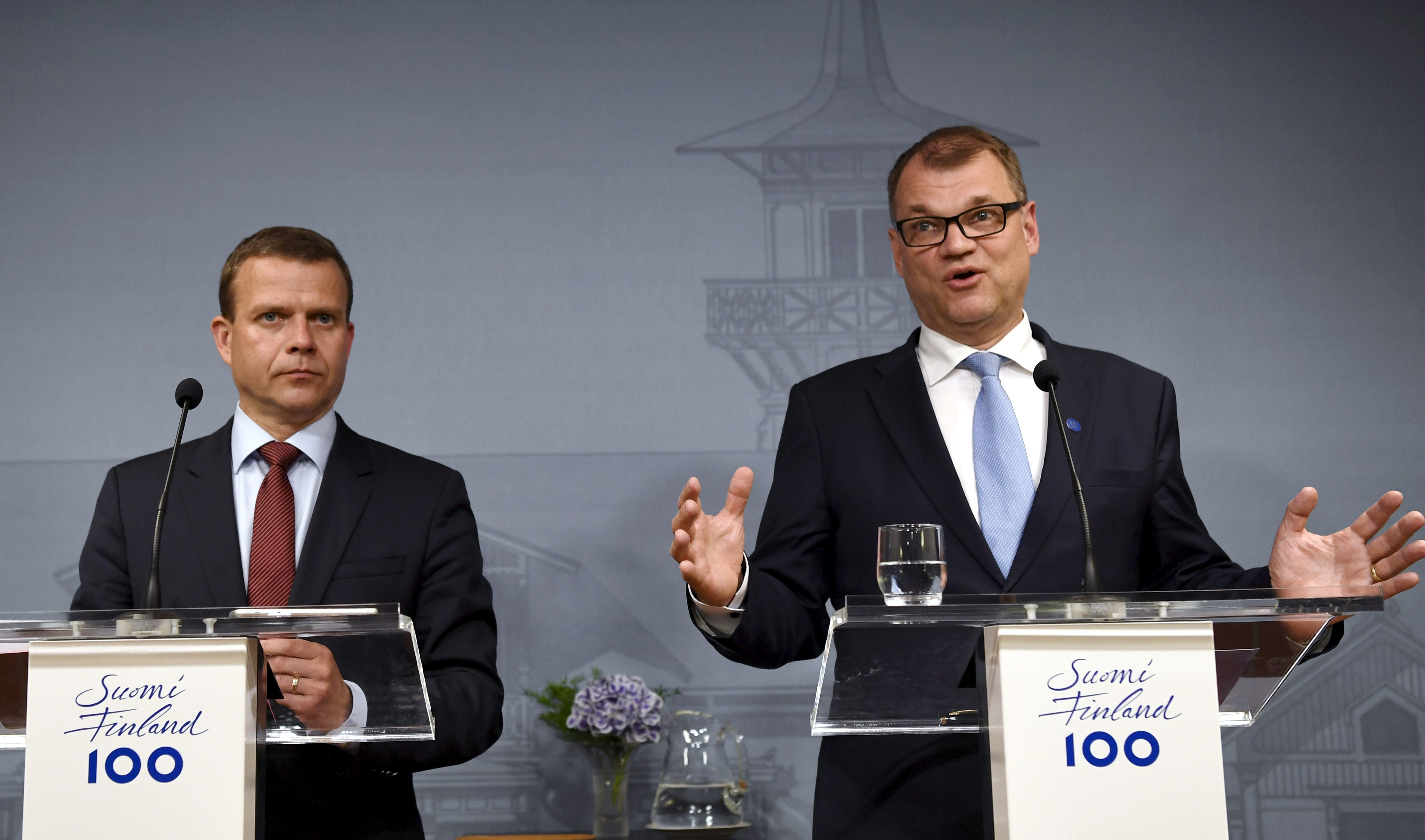 Finnish Minister of Finance and National Coalition chairman Petteri Orpo (L) and Finnish Prime Minister and Centre Party chairman Juha Sipila attend a news conference at the PM's official residence Kesaranta in Helsinki, Finland, June 12, 2017.