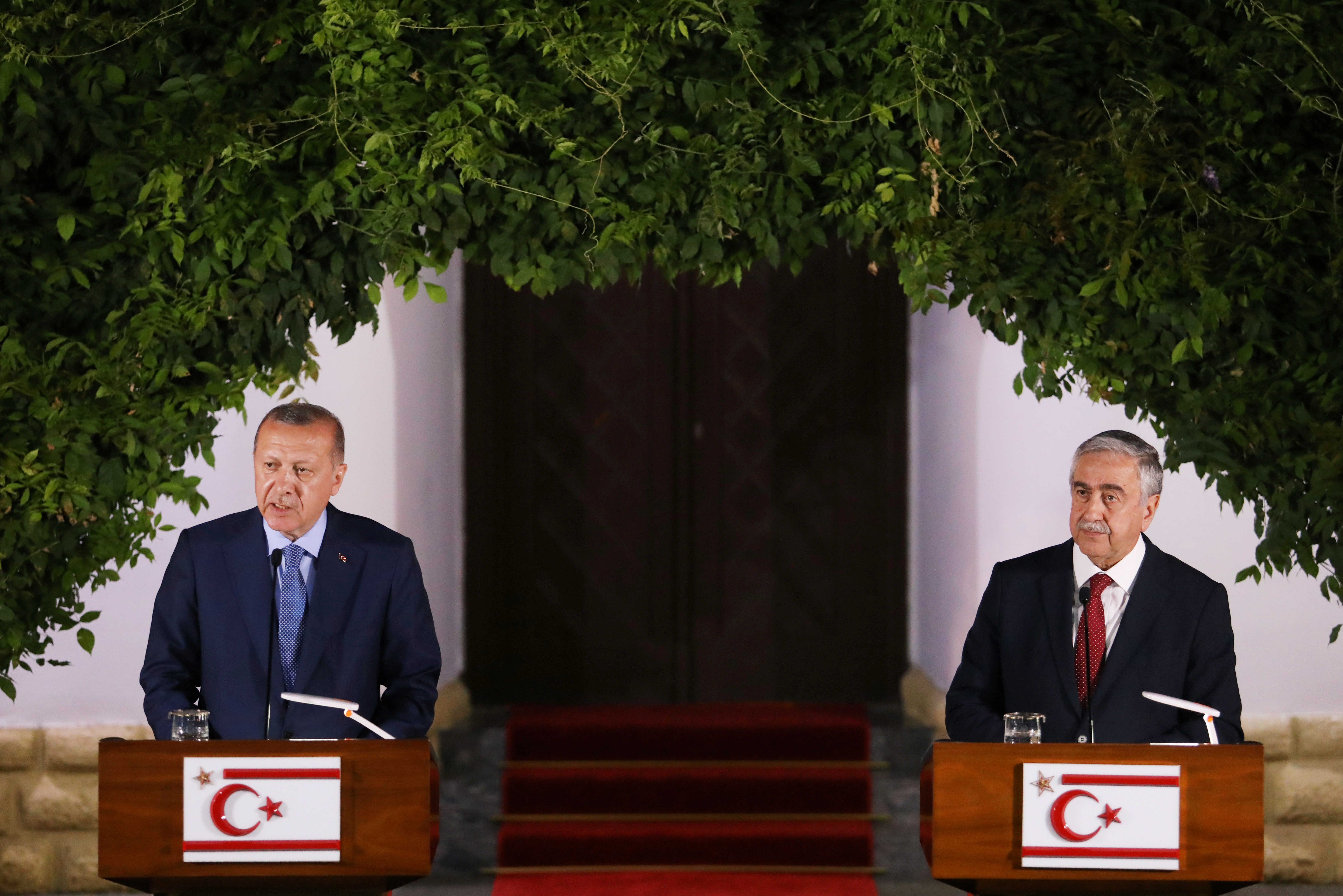 FILE - Turkish President Tayyip Erdogan, left, and Turkish Cypriot leader Mustafa Akinci talk at a news conference during a visit in the Turkish Cypriot northern part of the divided city of Nicosia, Cyprus, July 10,2018.