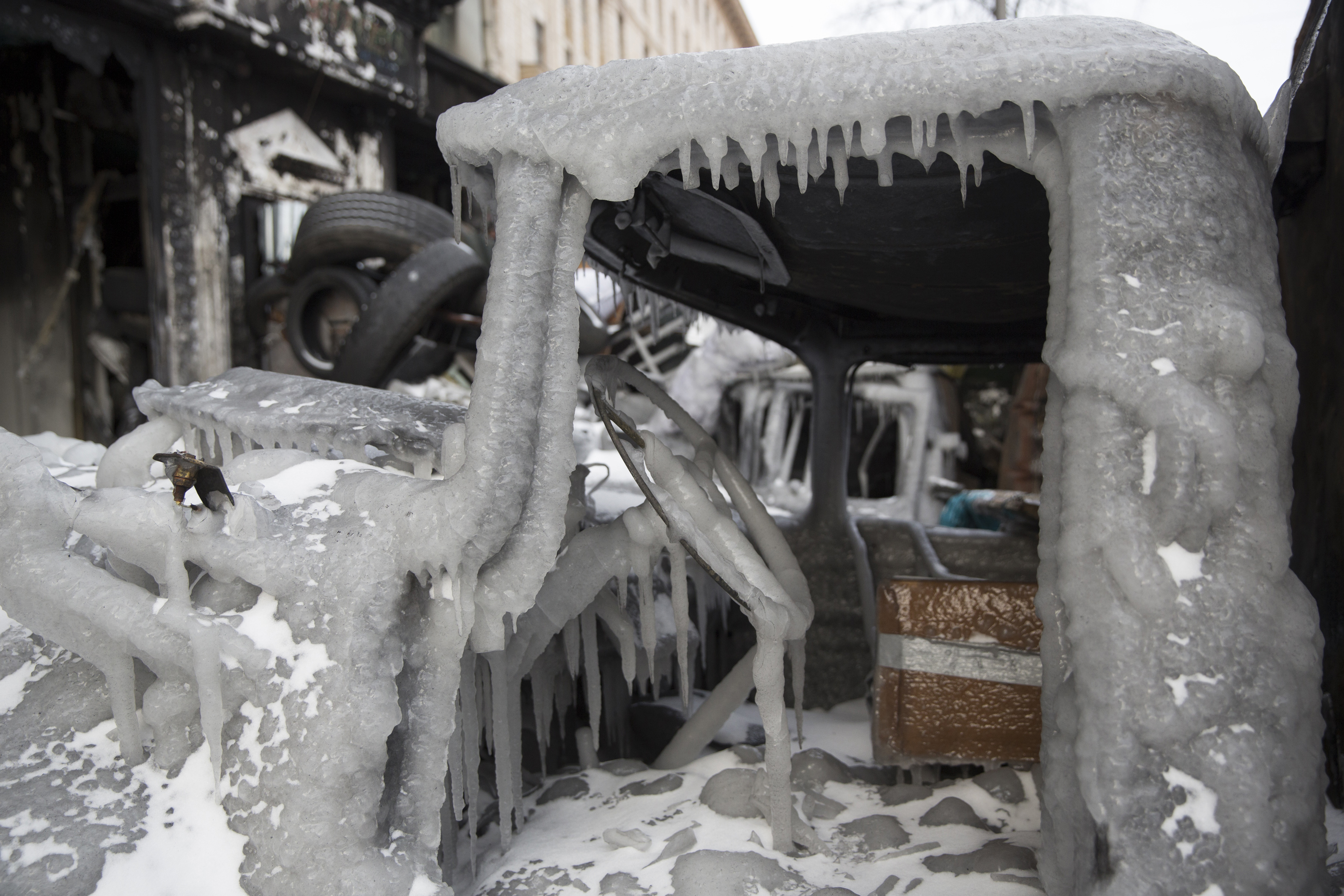 The cabin of a gutted truck is seen covered with ice at fortifications erected by anti-government protesters in Kiev, January 29, 2014. Ukrainian Prime Minister Mykola Azarov resigned on Tuesday while deputies loyal to President Viktor Yanukovich, ac