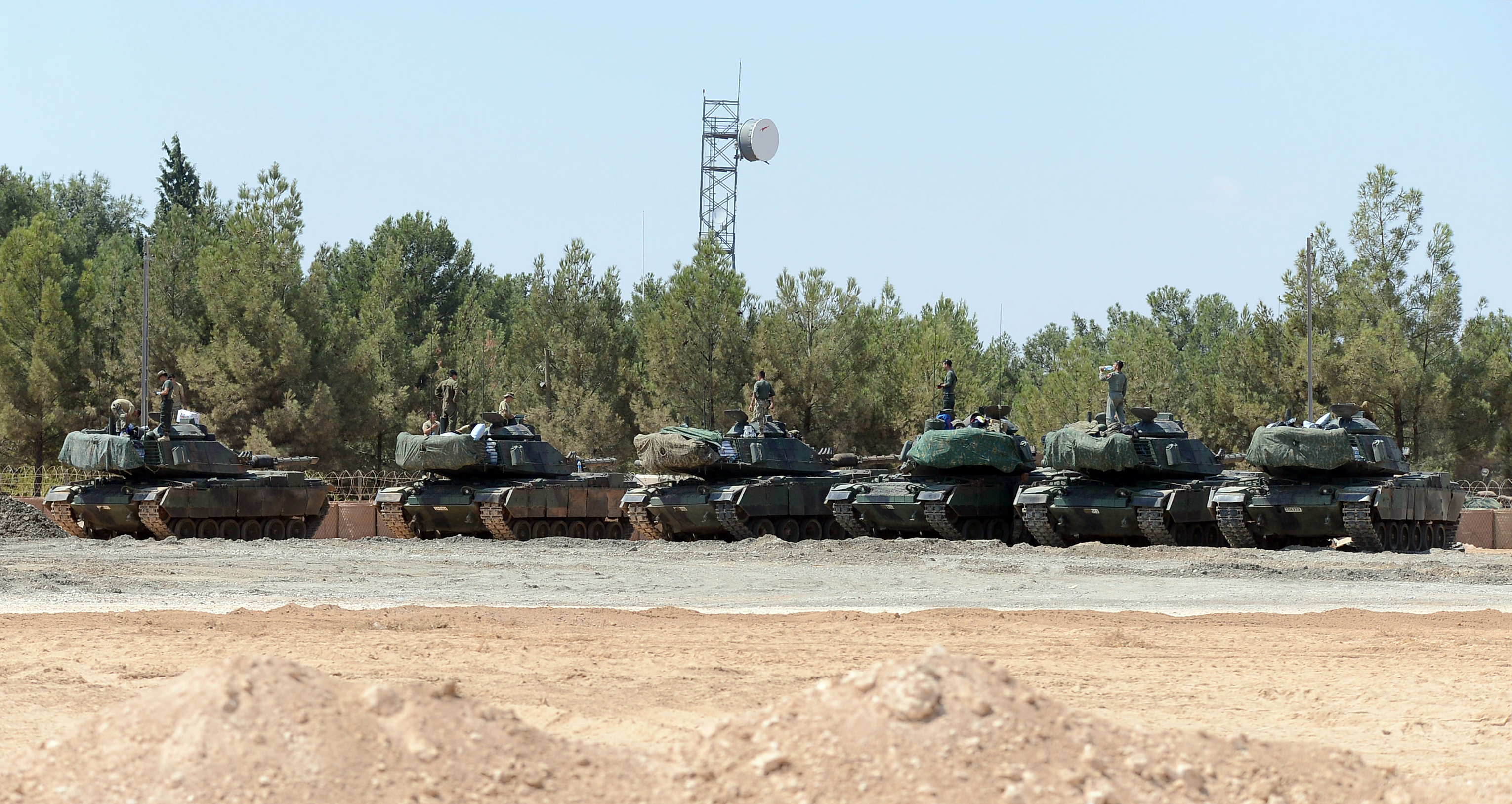 """Turkish tanks stationed near the Syrian border, in Karkamis, Turkey, Saturday, Sept. 3, 2016. Turkey's state-run news agency says Turkish tanks have entered Syria's Cobanbey district northeast of Aleppo in a """"new phase"""" of the Euphrates Shield operat..."""