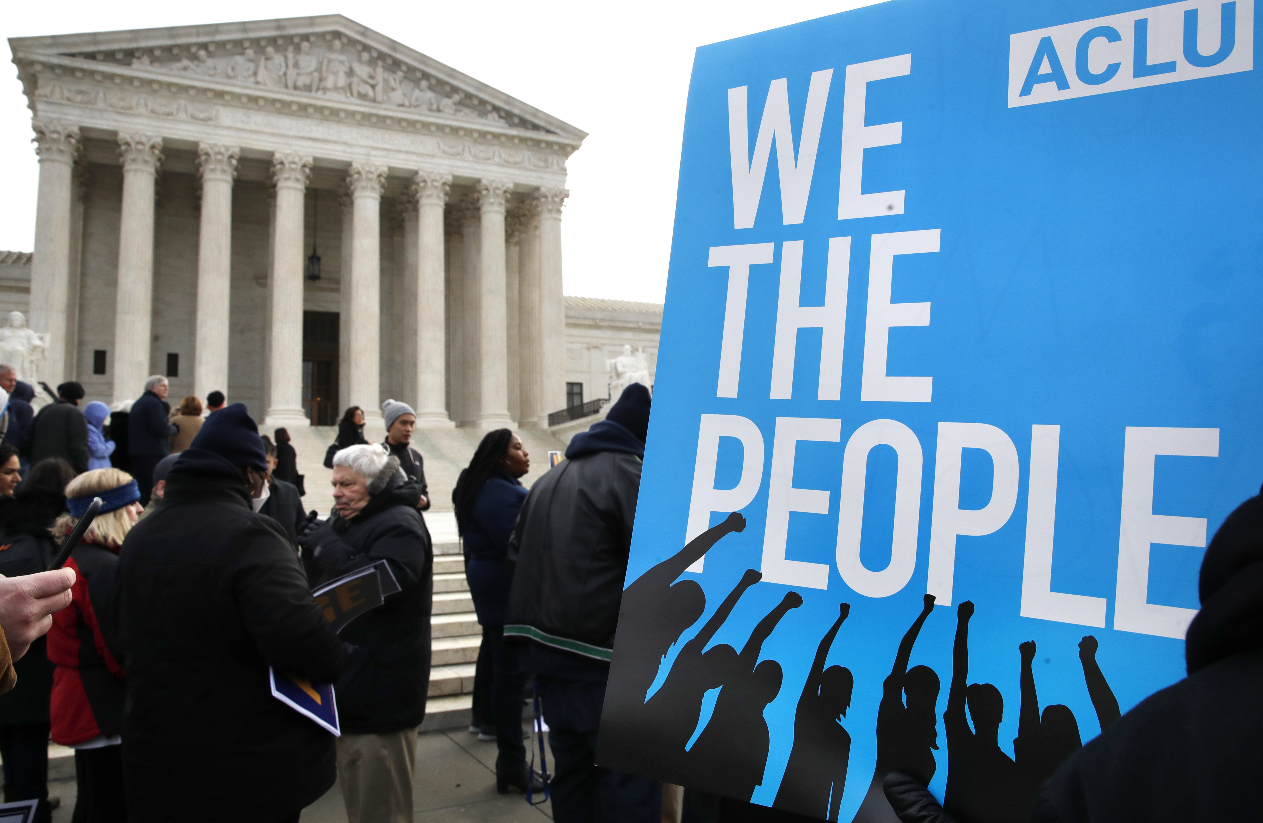 FILE - People rally outside of the Supreme Court in opposition to Ohio's voter roll purges in Washington, Jan. 10, 2018.