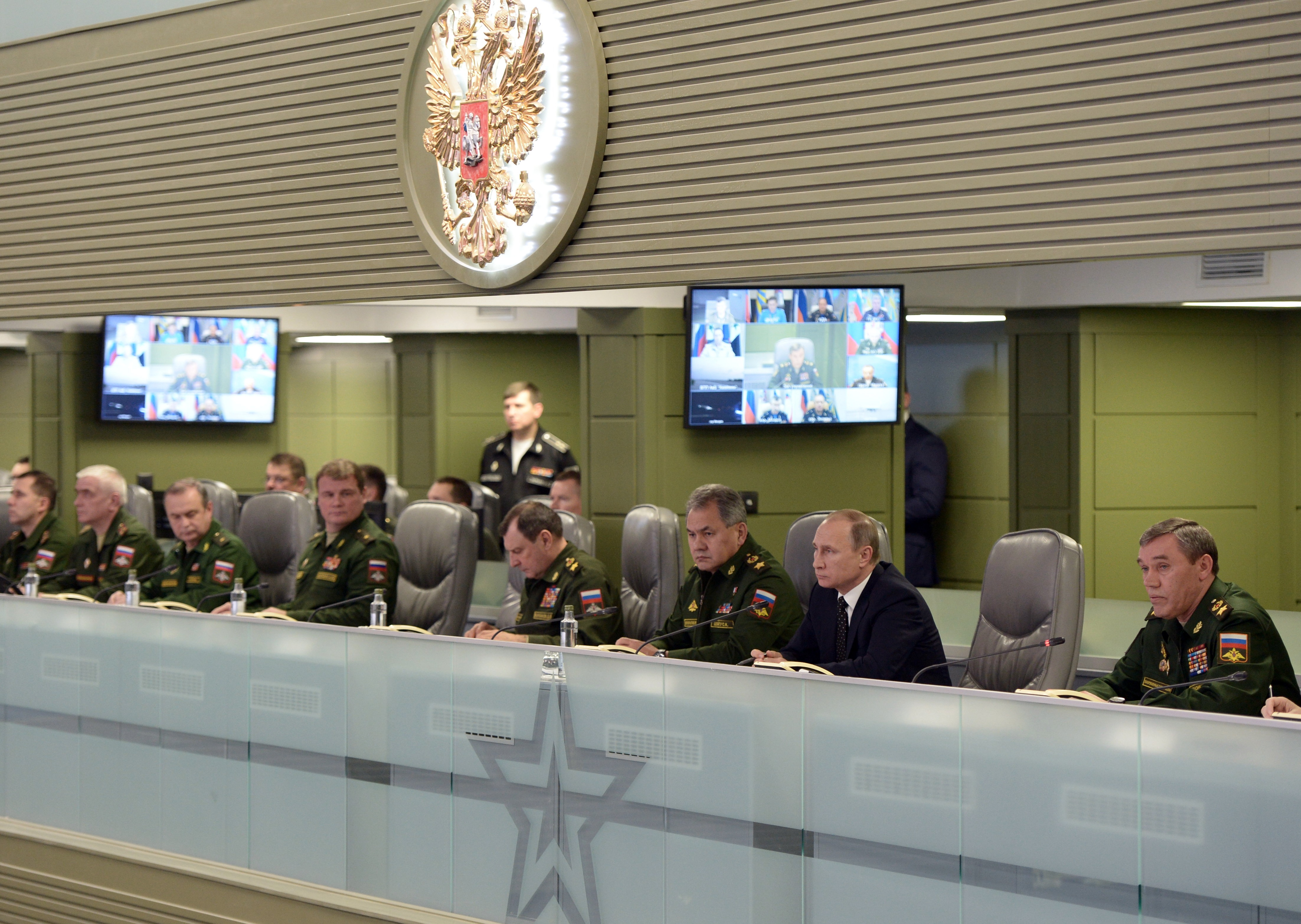 Russian President Vladimir Putin, second right, flanked by Defense Minister Sergei Shoigu, third right, and Chief of the General Staff of the Russian Armed Forces Valery Gerasimov, right, attends a meeting on Russian airspace forces' activities in Sy...