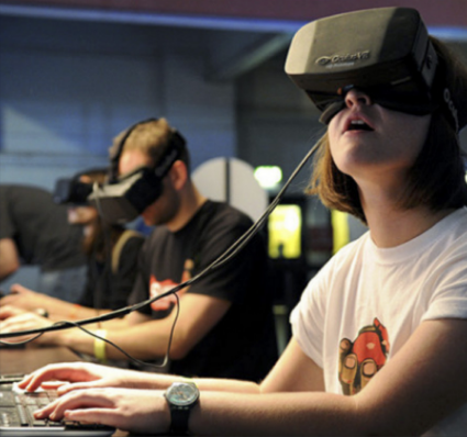 Students use virtual reality for an immersive educational experience. VR blocks out the physical world and transports the user to a simulated world. (Courtesy Dell.com)