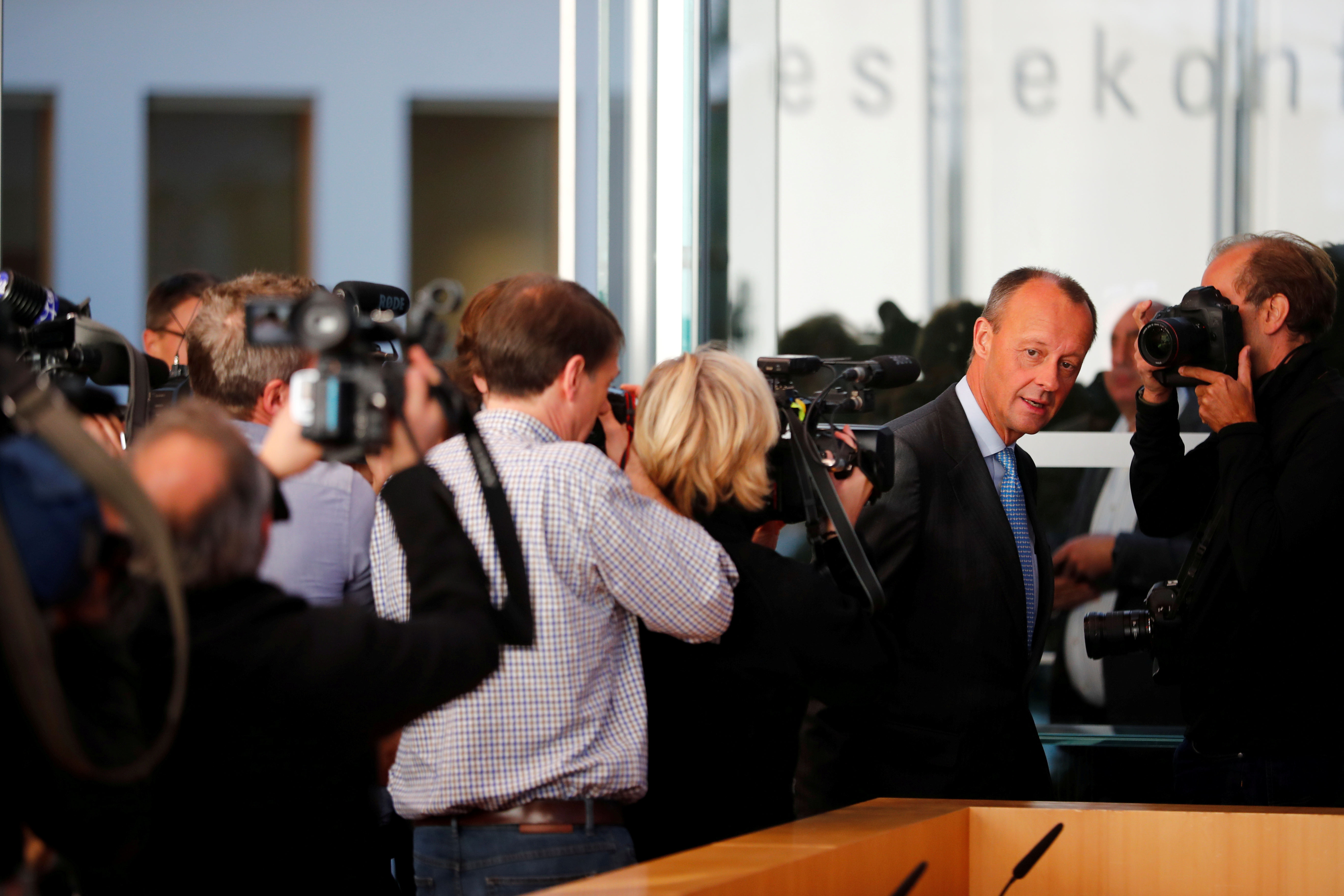 FILE - German conservative Friedrich Merz arrives for a news conference about his candidacy to succeed Chancellor Angela Merkel as leader of the Christian Democrats, in Berlin, Germany, Oct. 31, 2018.