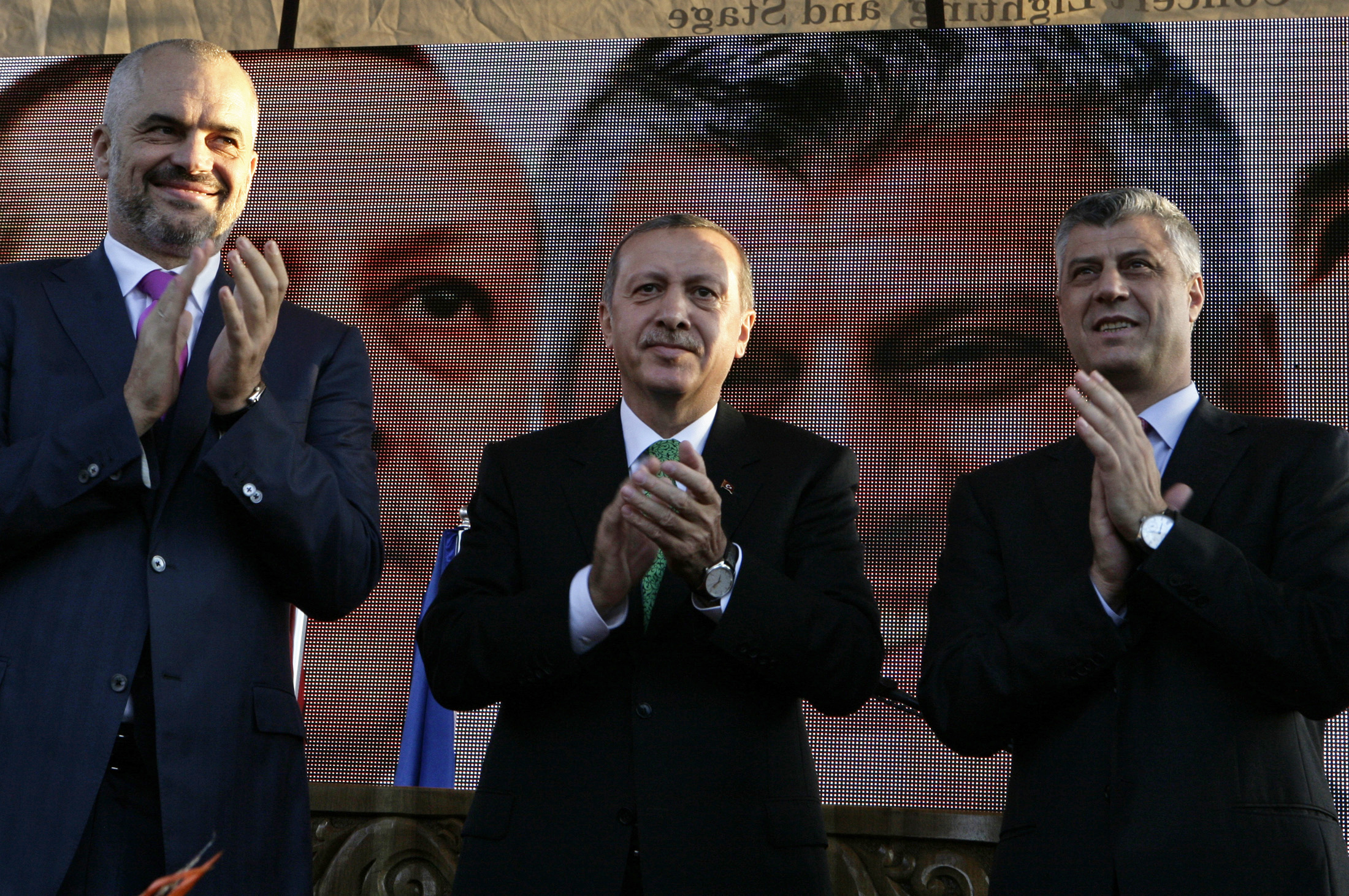 FILE - Turkish Prime Minister Tayyip Erdogan (C), his Albanian counterpart Edi Rama (L) and then-Kosovar counterpart Hashim Thaci clap during a visit to Prizren, southwest of capital, Pristina, Oct. 23, 2013.