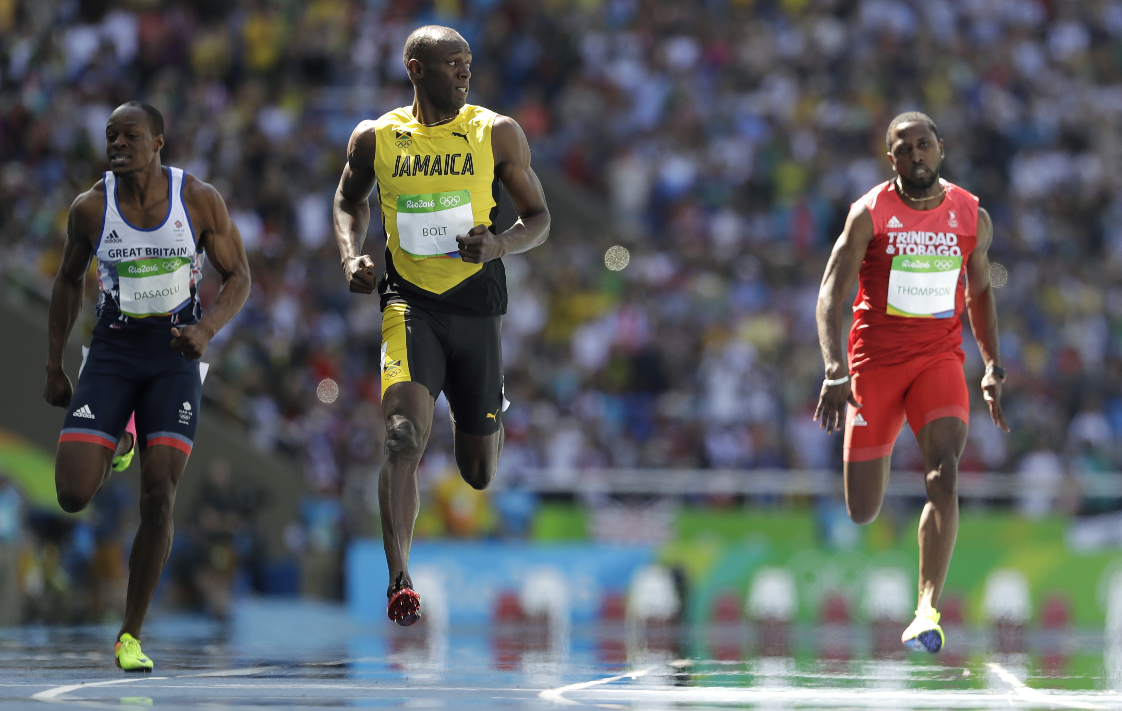 Jamaica's Usain Bolt, center, Trinidad and Tobago's Richard Thompson, right, and Britain's James Dasaolu compete in a men's 100-meter heat during the athletics competitions of the 2016 Summer Olympics at the Olympic stadium in Rio de Janeiro, Brazil,