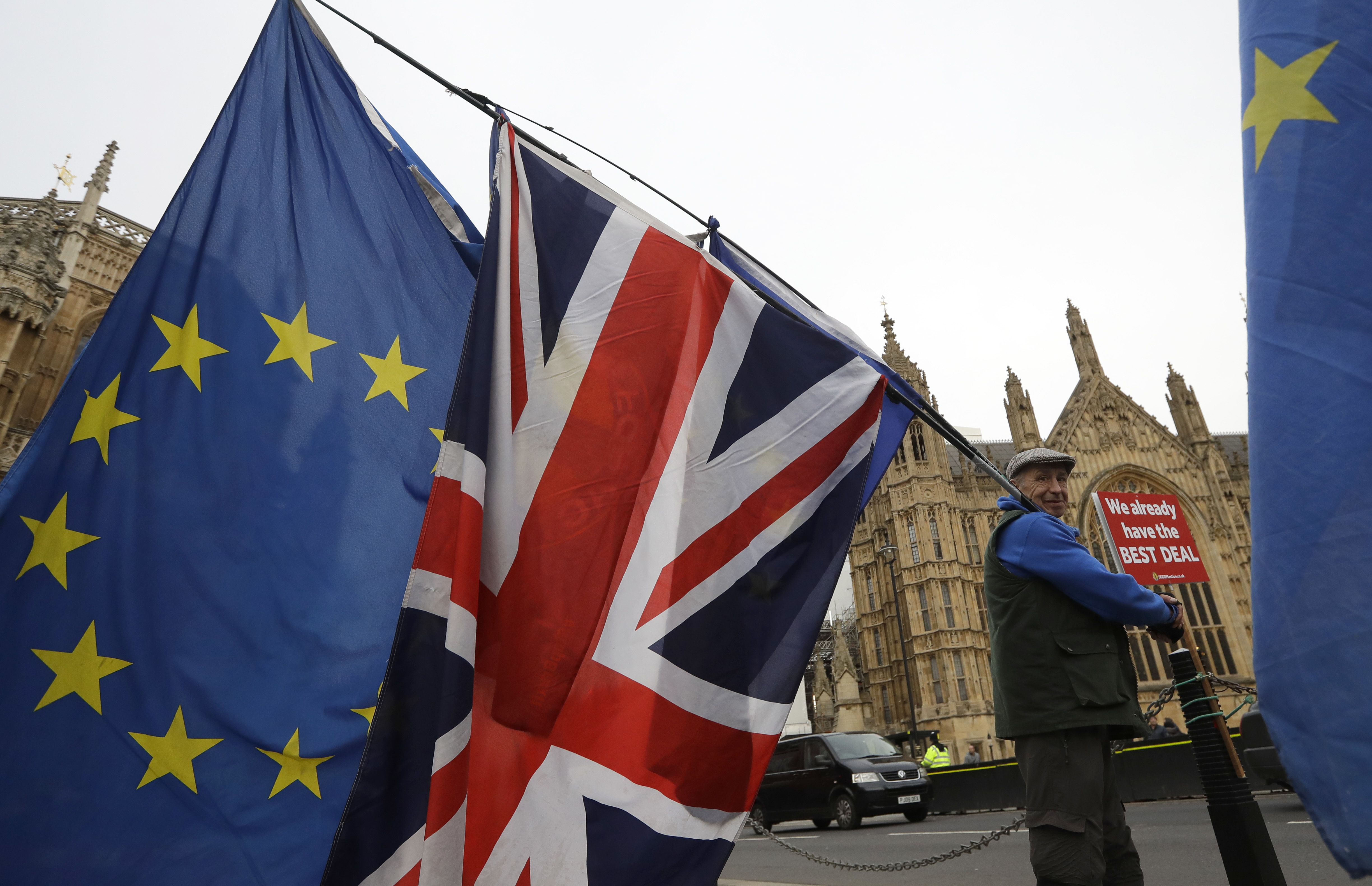 An anti-Brexit campaigner waves flags in Westminster in London, Dec. 4, 2018.